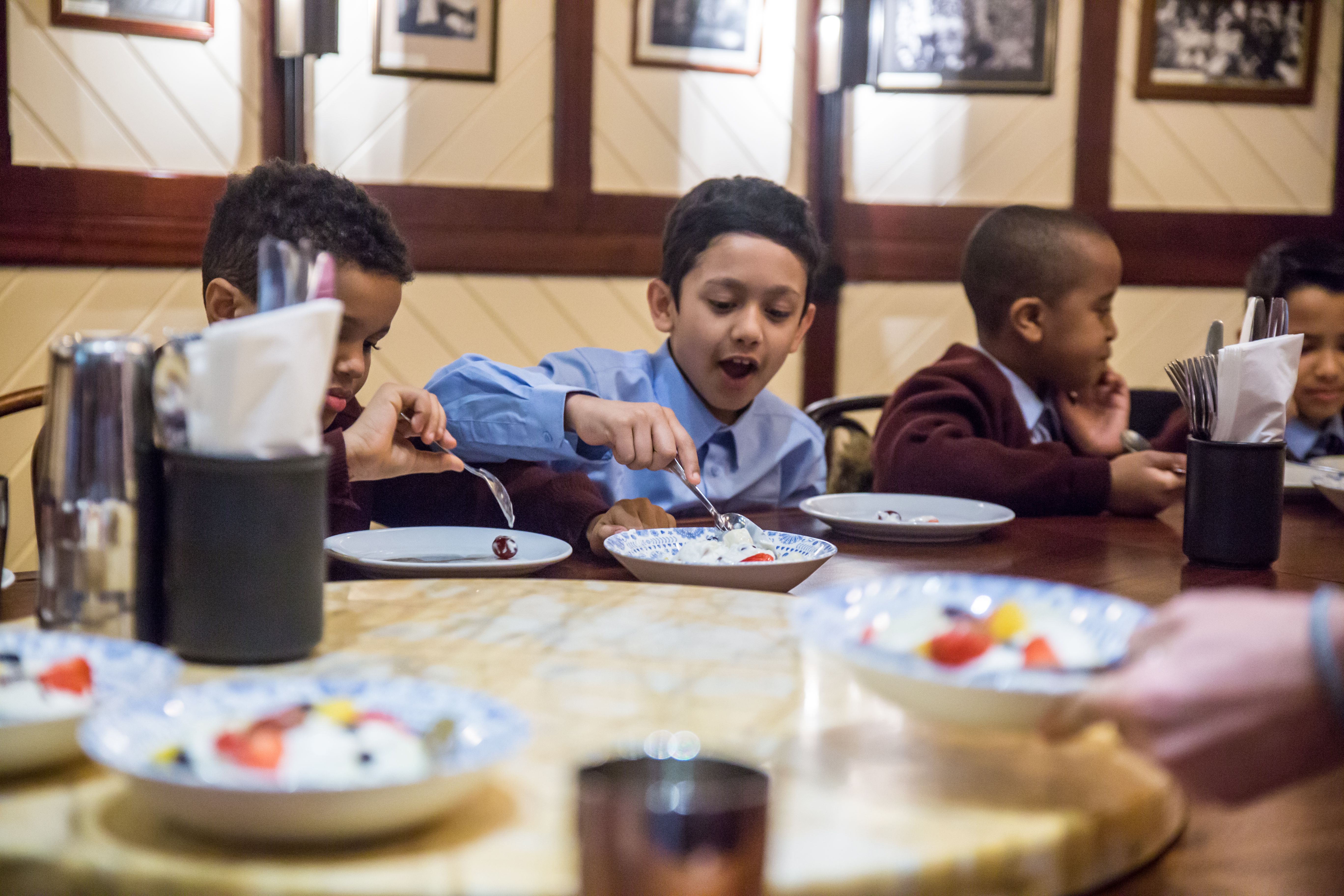 Children enjoy breakfast at Indian cafe chain Dishoom as part of the Magic Breakfast charity initiative