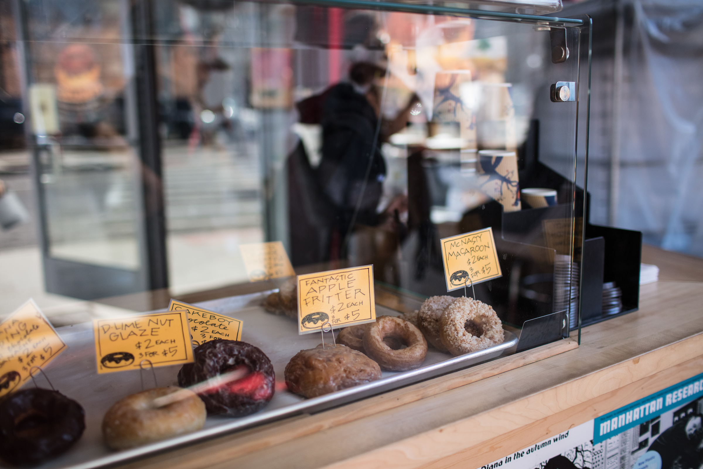 Doughnuts behind a sneeze guard at Dilla's Delights on opening day.