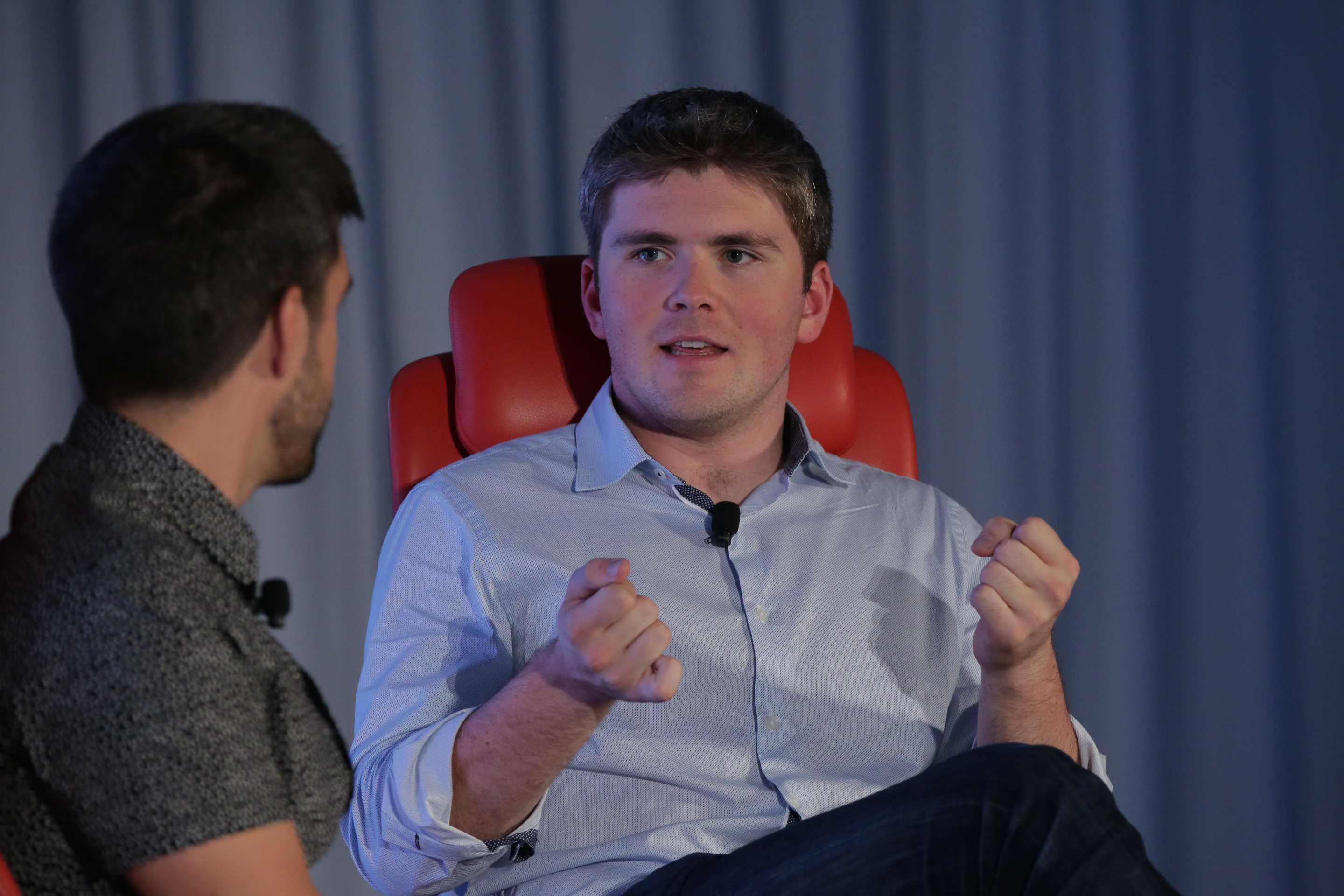 Stripe co-founder and president John Collison onstage at Code Commerce 2018
