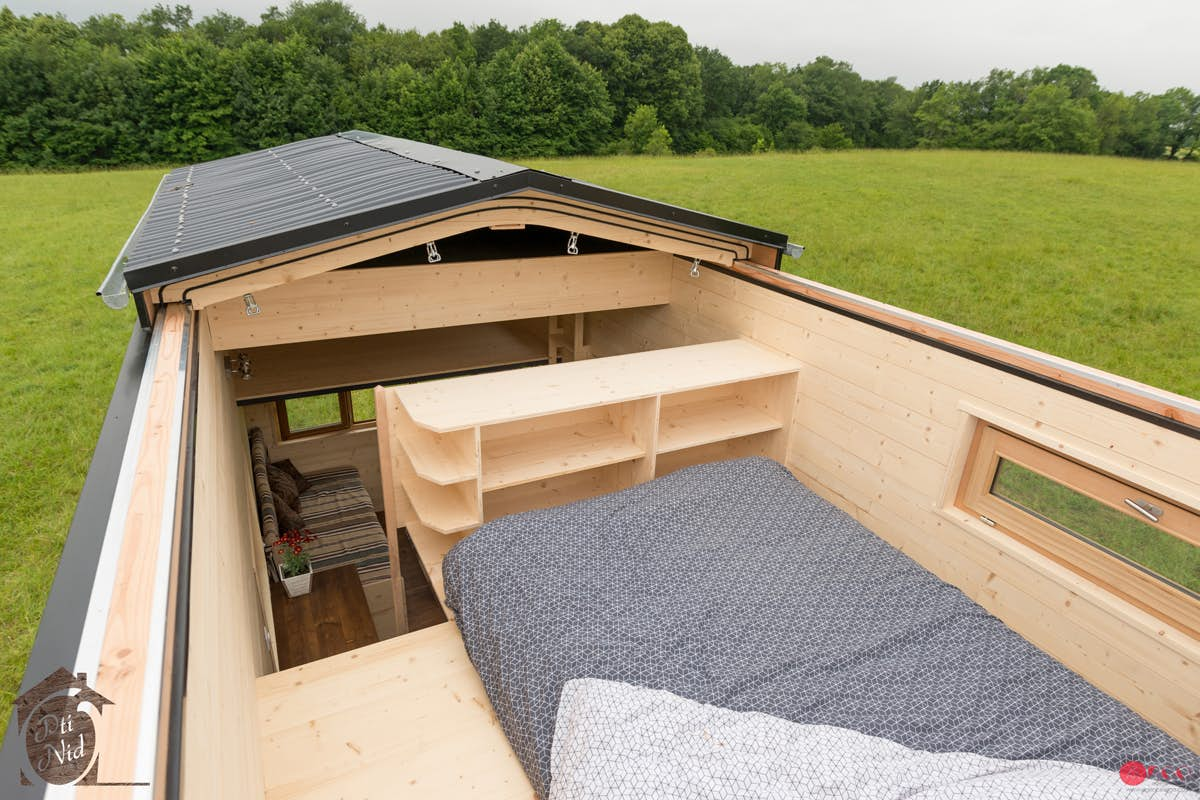 Lofted bedroom with no ceiling