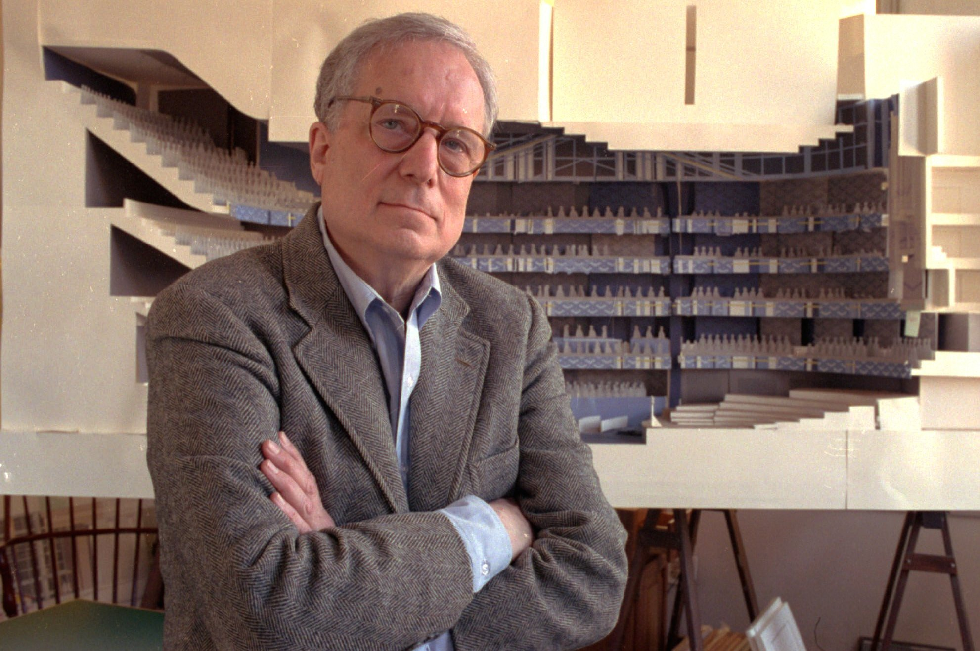 Architect Robert Venturi poses in his office in the Manayunk section of Philadelphia, with a model of a new hall for the Philadelphia Orchestra in background, in April of 1991.
