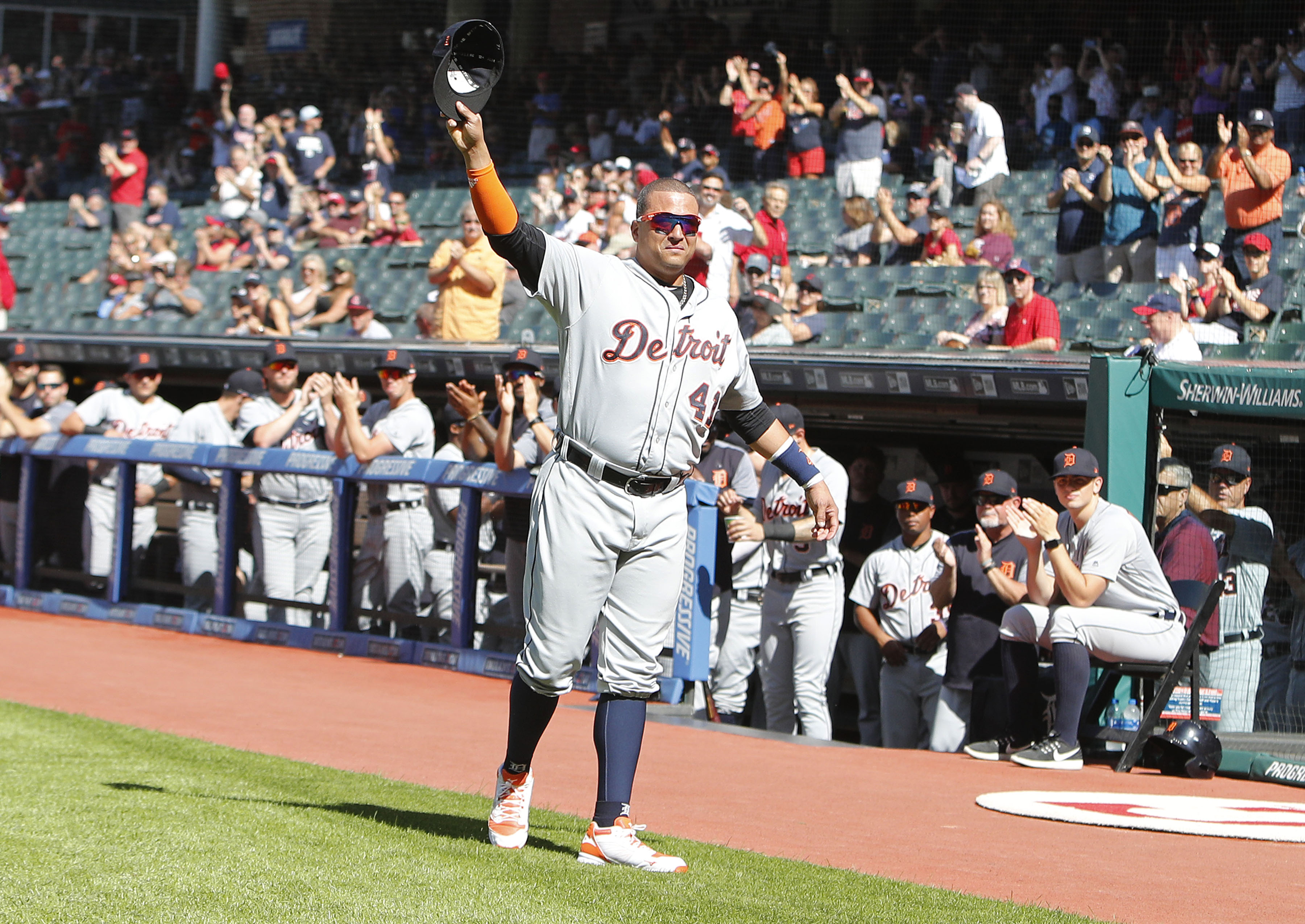 Victor Martinez waves to fans in Cleveland.