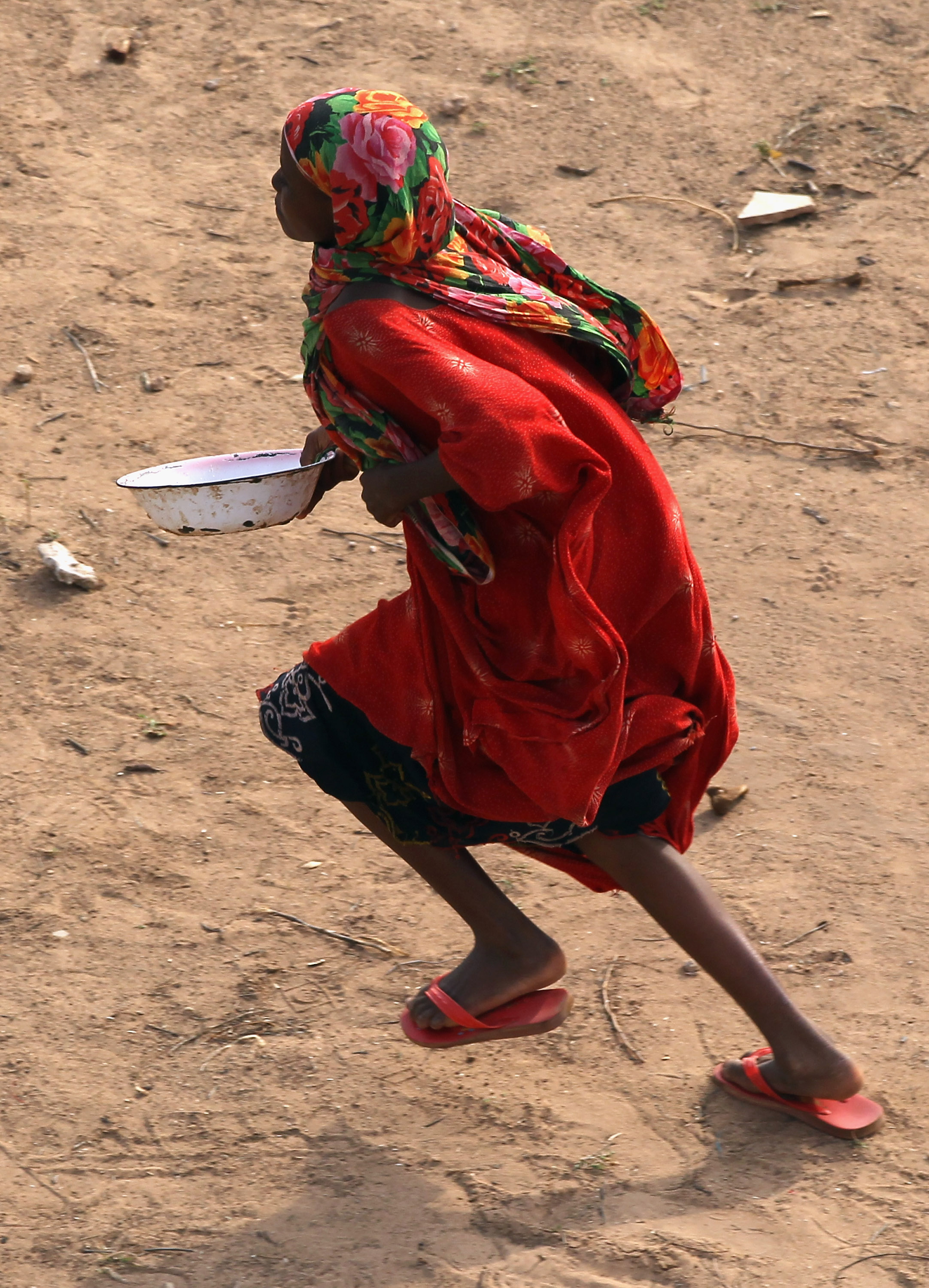 Somali girl runs to get in line for food in 2011