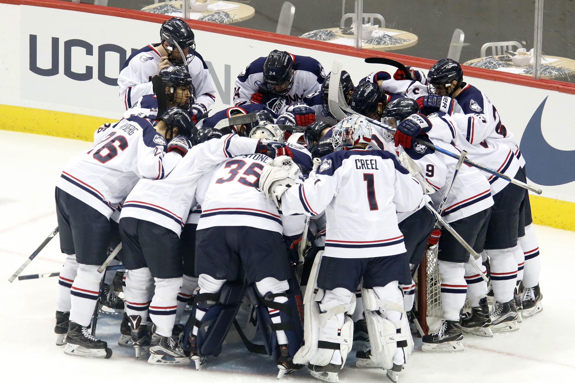 The UConn men's hockey team huddles up before their game against Northeastern at the XL Center in Hartford, CT  on November 28, 2017.