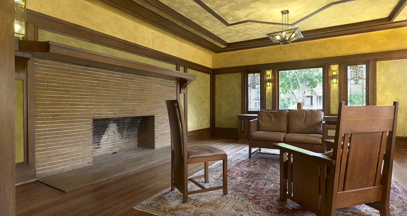 Sitting room with large brick fireplace