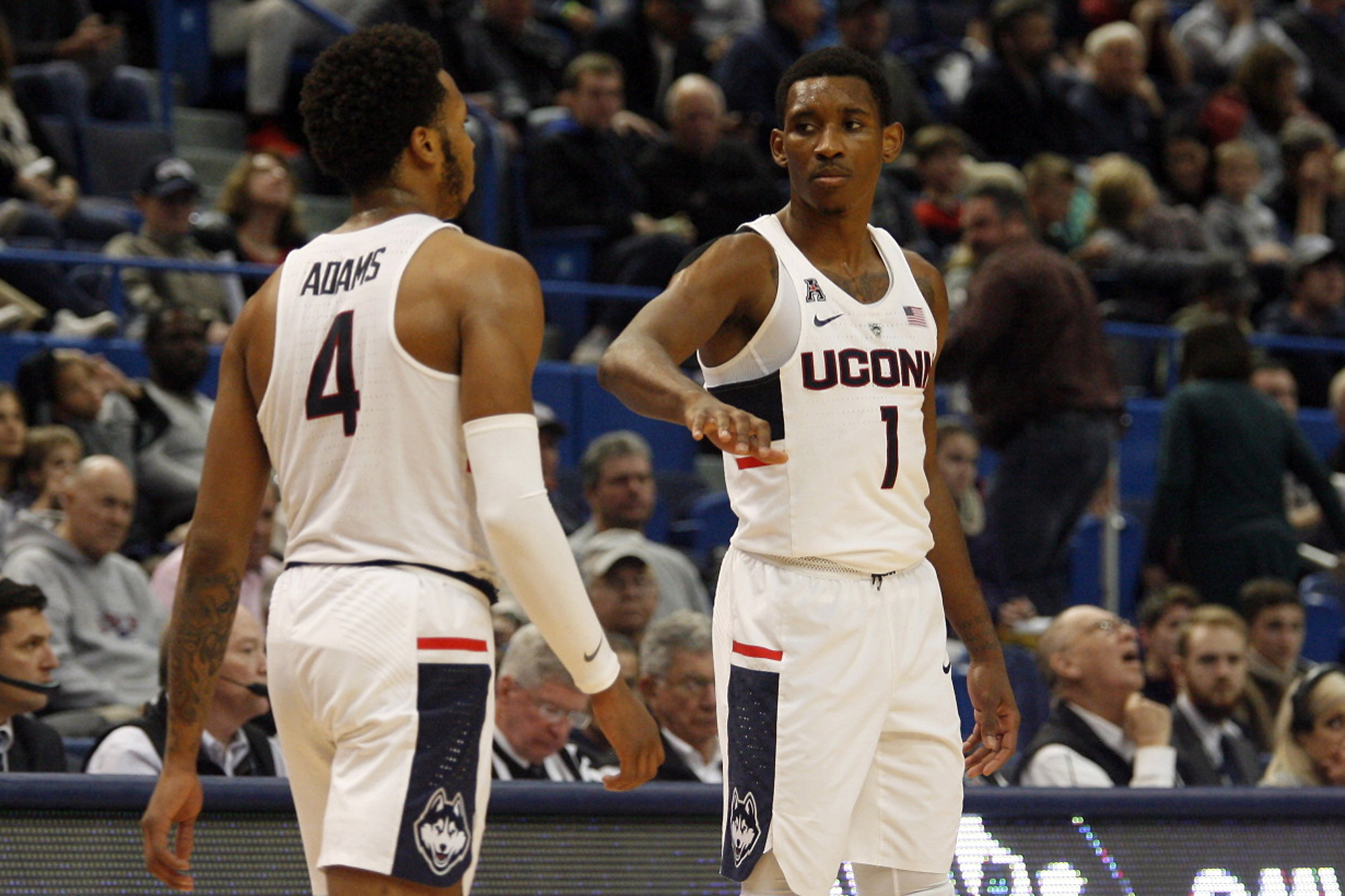 UConn's Christian Vital (1) and Jalen Adams (4) during the Monmouth Hawks vs UConn Huskies men's college basketball game at the XL Center in Hartford, CT on December 2, 2017.