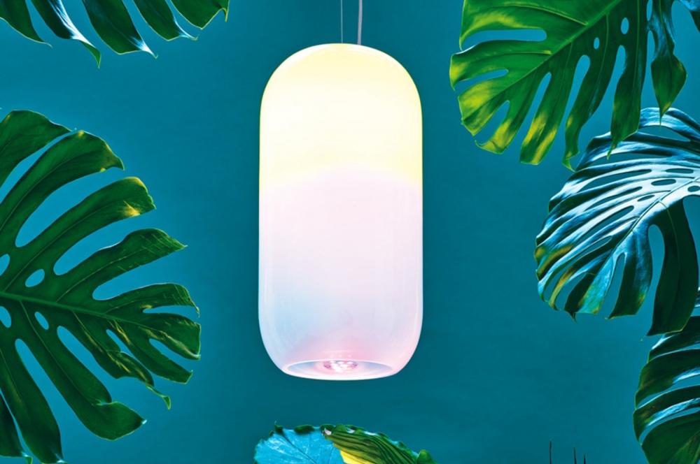Glowing lamp hanging among plants