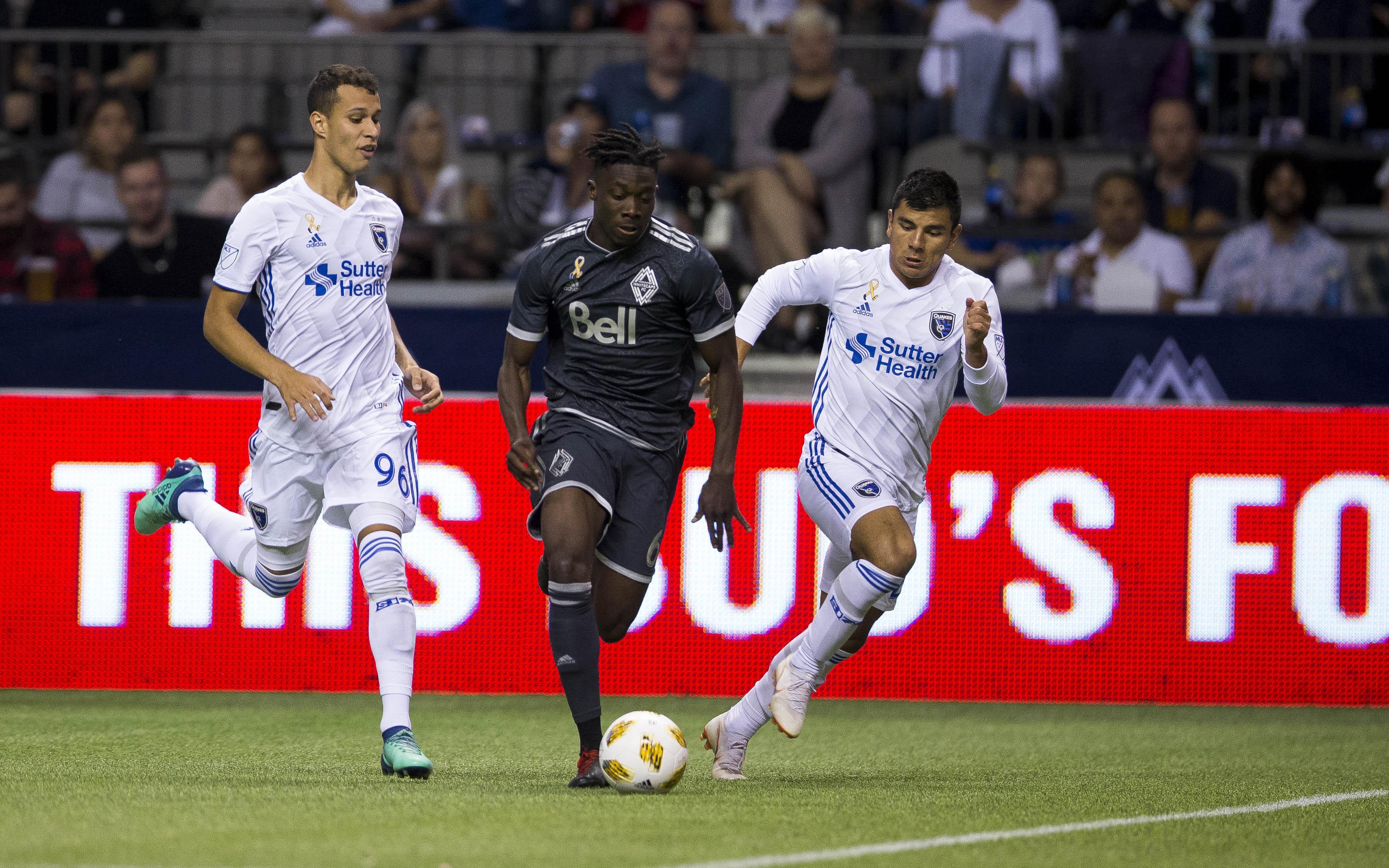 MLS: San Jose Earthquakes defenders chase Vancouver Whitecaps' midfielder Alphonso Davies on the ball