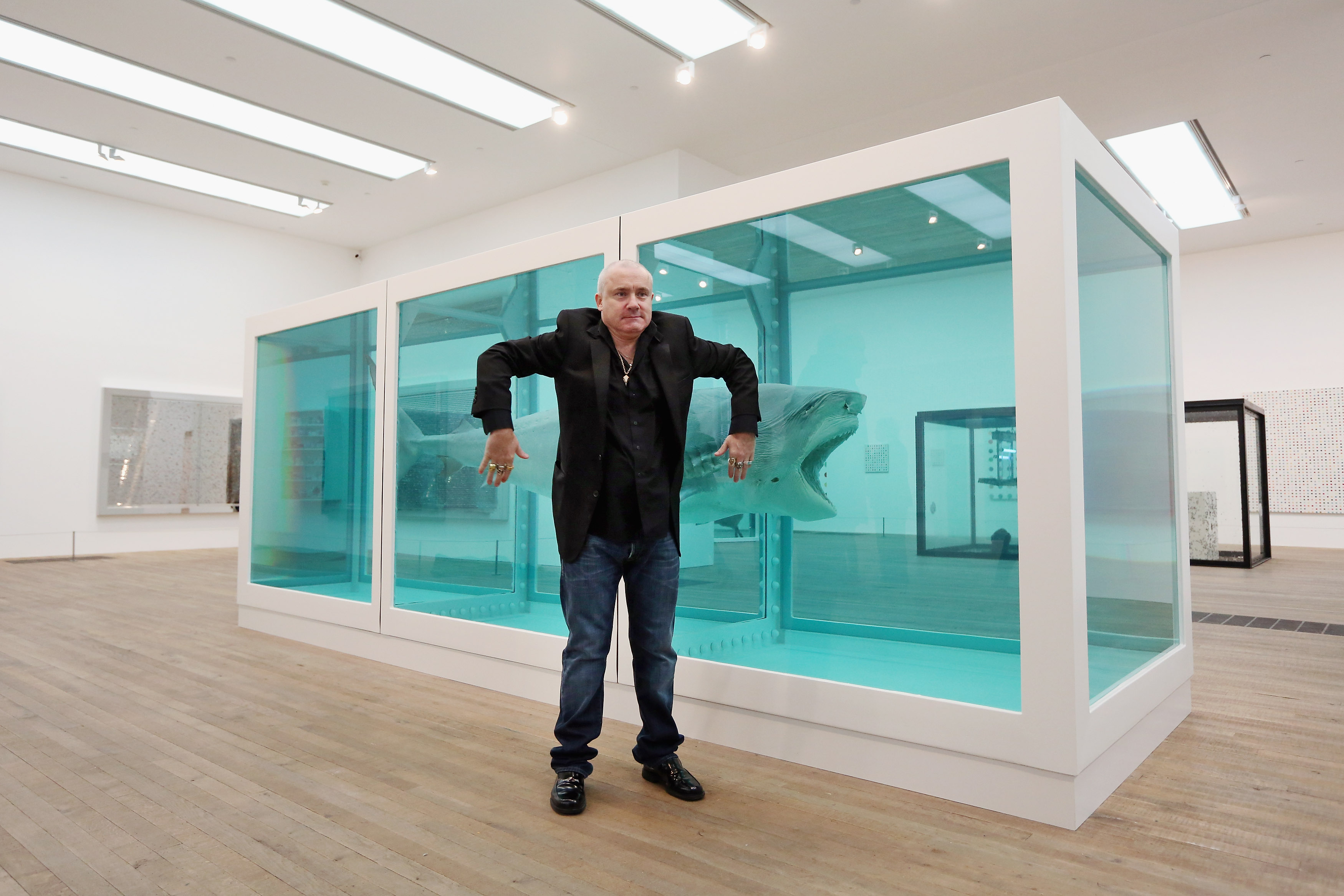 Damien Hirst poses with his formaldehyde shark — the Cock and Bull artist dined at Piccadilly hotel The Wolseley in London this week