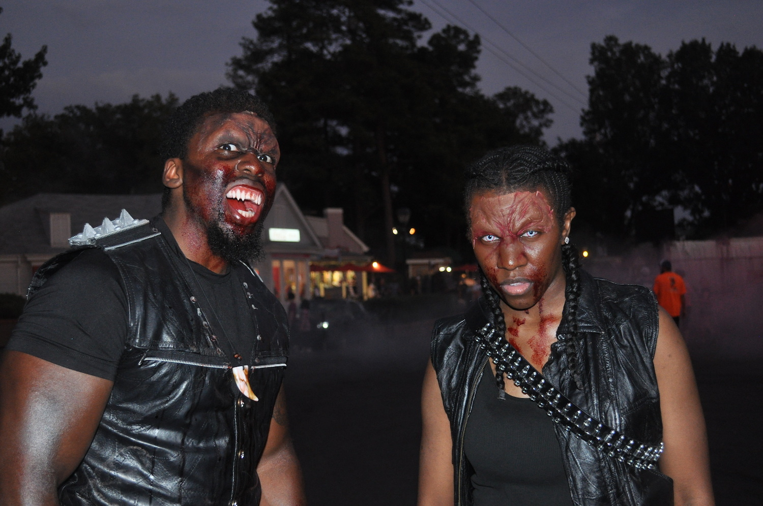 Two men wearing Halloween makeup to look like vampires.