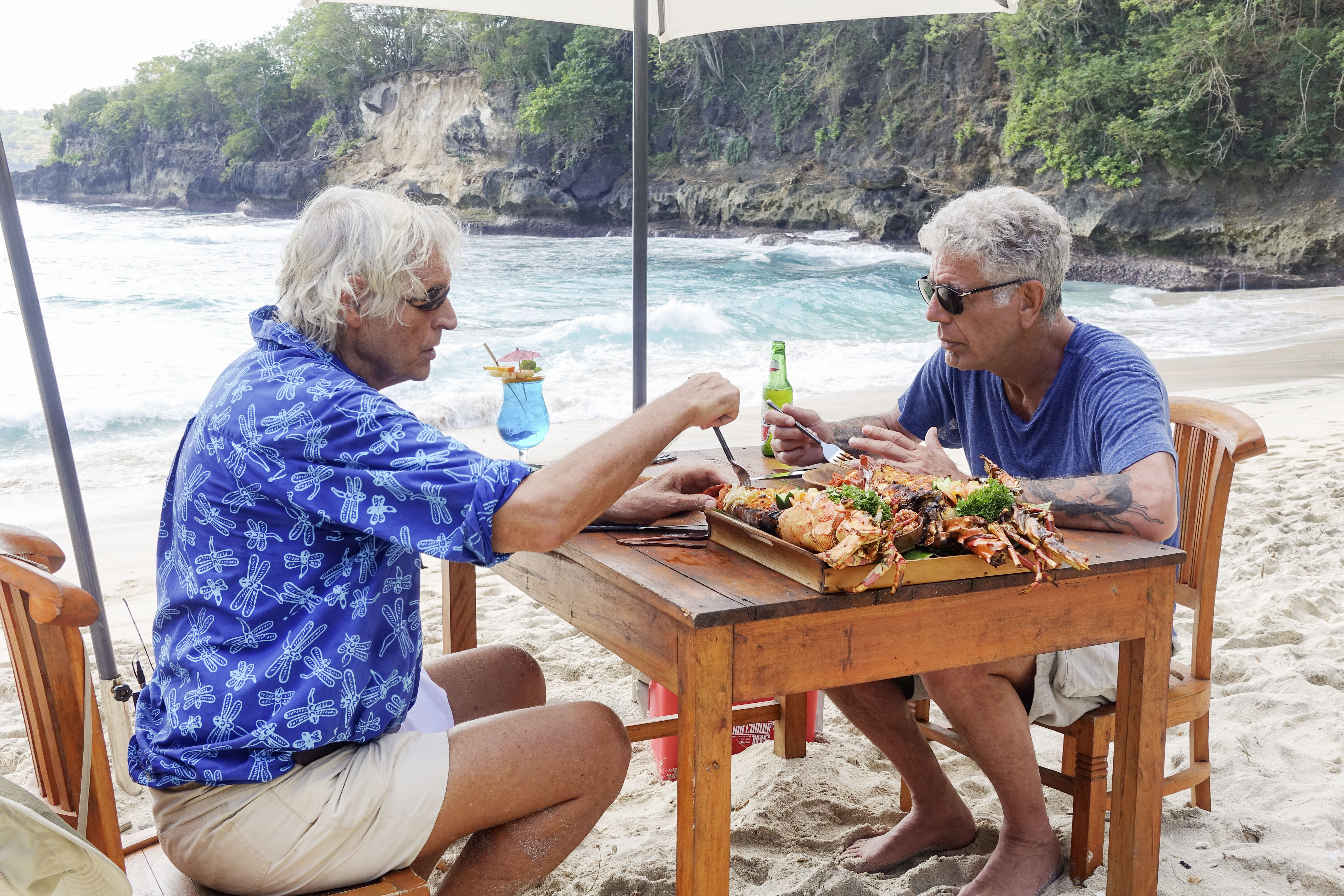 A discussion about Balinese funerals commences over an epic meal on the beach between Anthony Bourdain and an Indonesian local