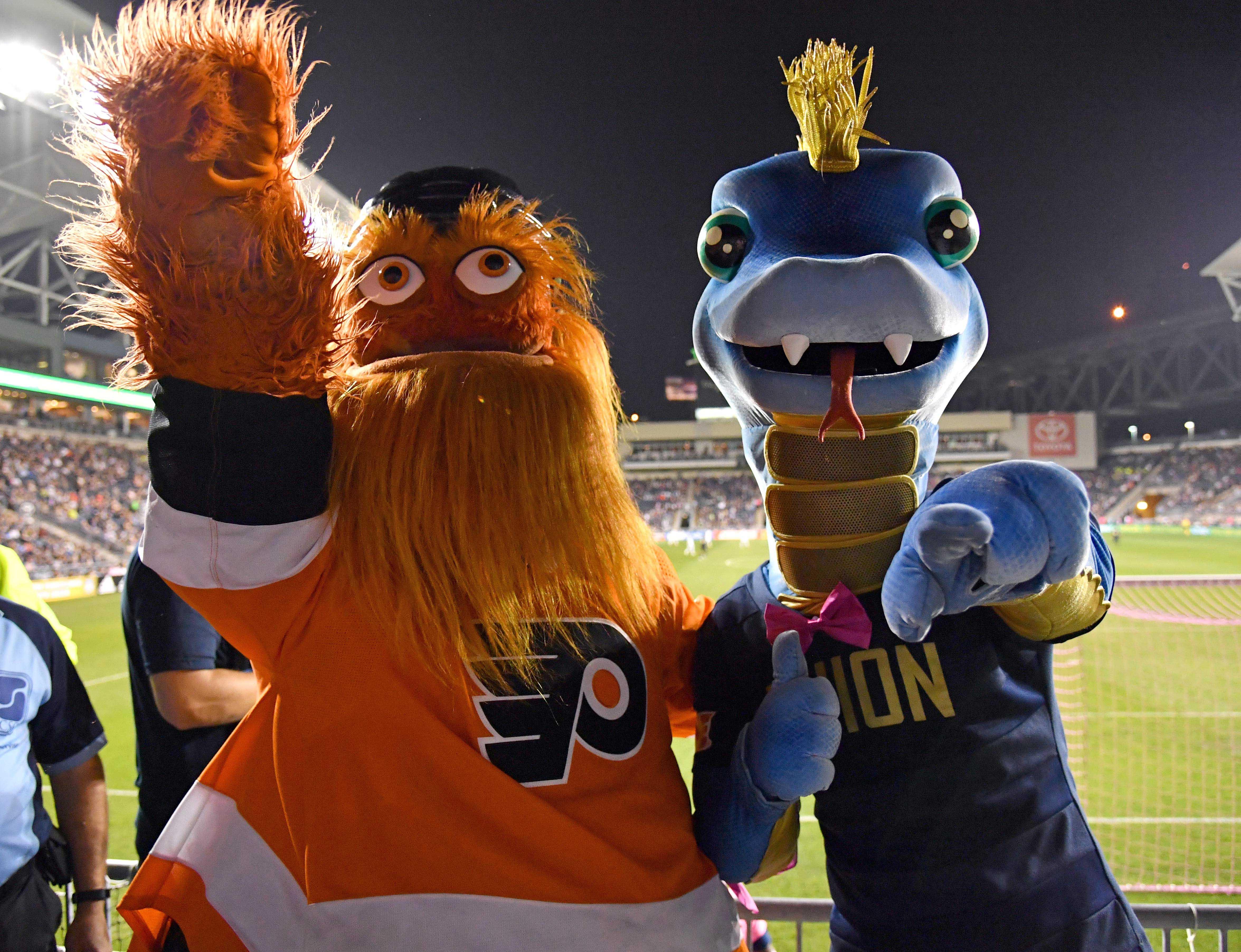 Oct 6, 2018; Philadelphia, PA, USA; Philadelphia Flyers mascot Gritty and Philadelphia Union mascot Phang during the first half against the Minnesota United at Talen Energy Stadium.