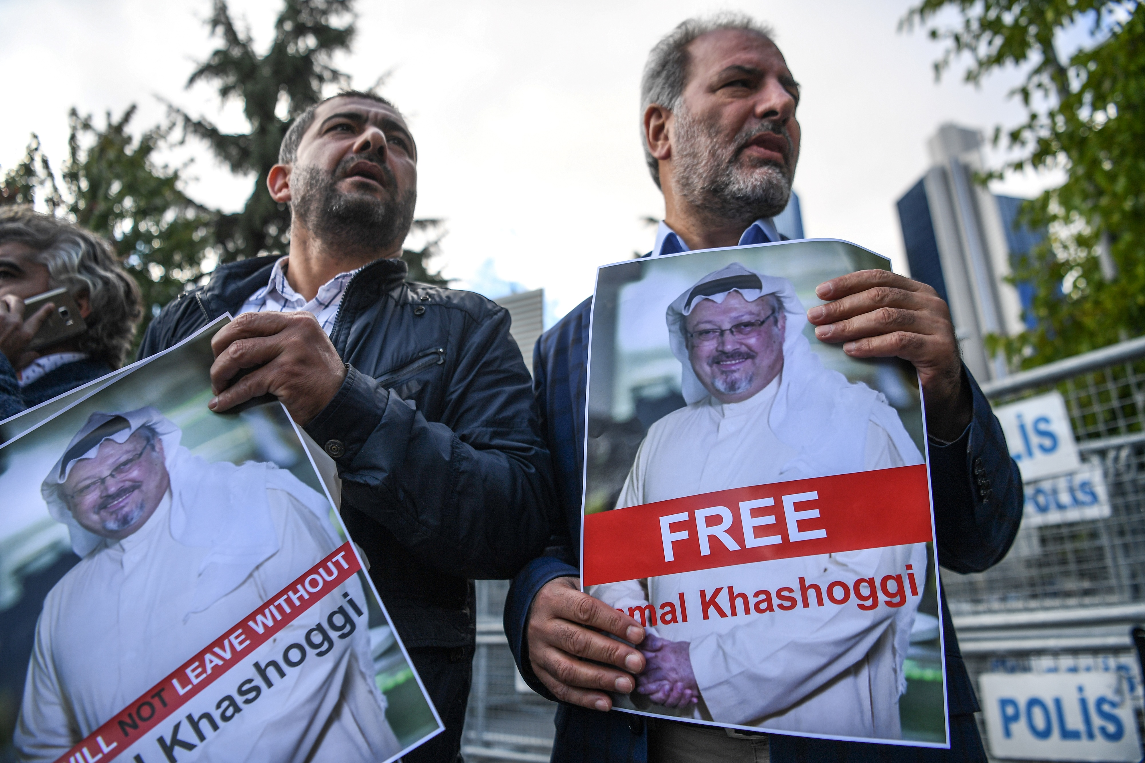 Protestors hold pictures of missing Saudi journalist Jamal Khashoggi during a demonstration in front of the Saudi Arabian consulate, on October 5, 2018 in Istanbul.