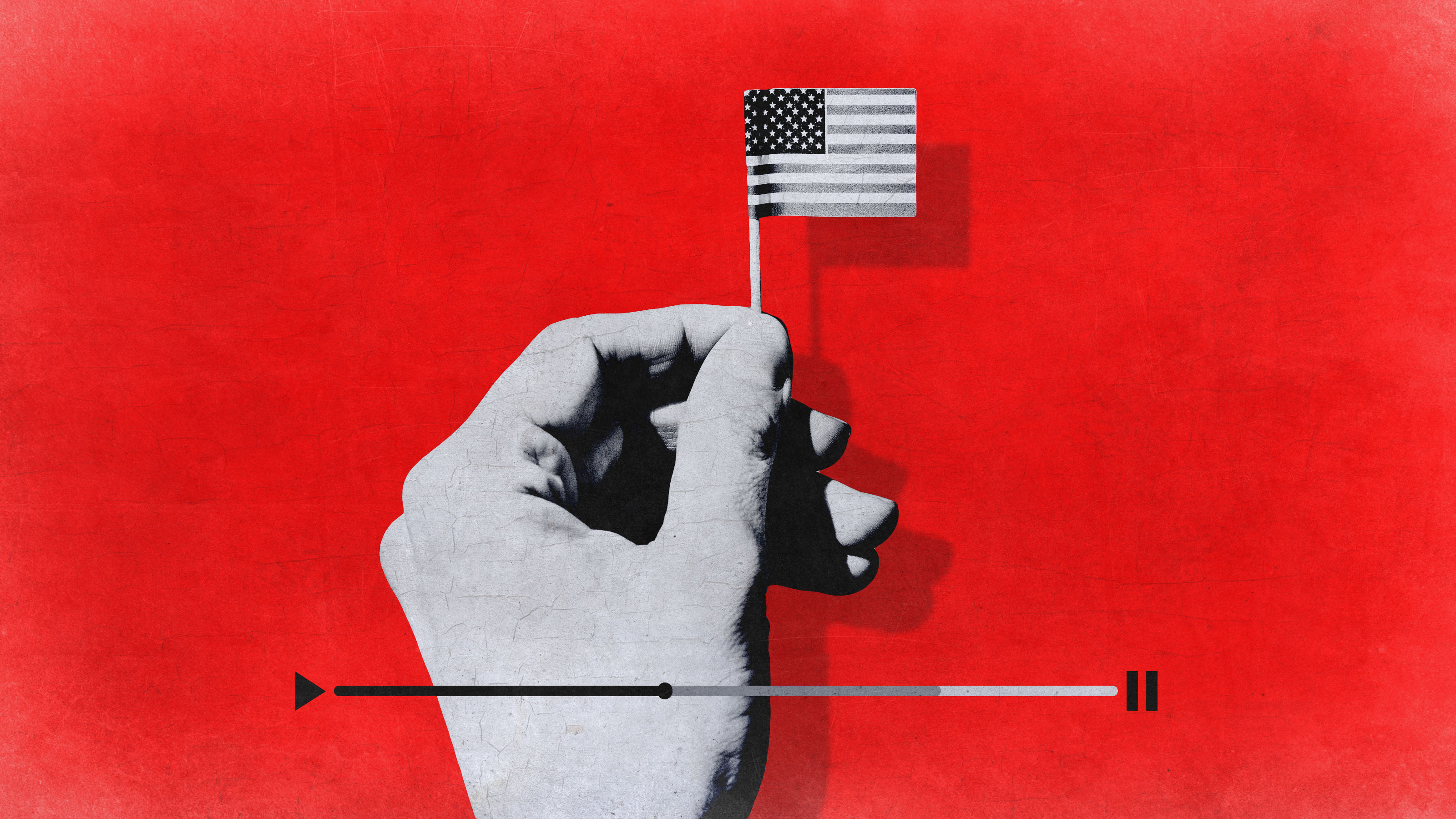 A hand holding a small American flag above a video playhead