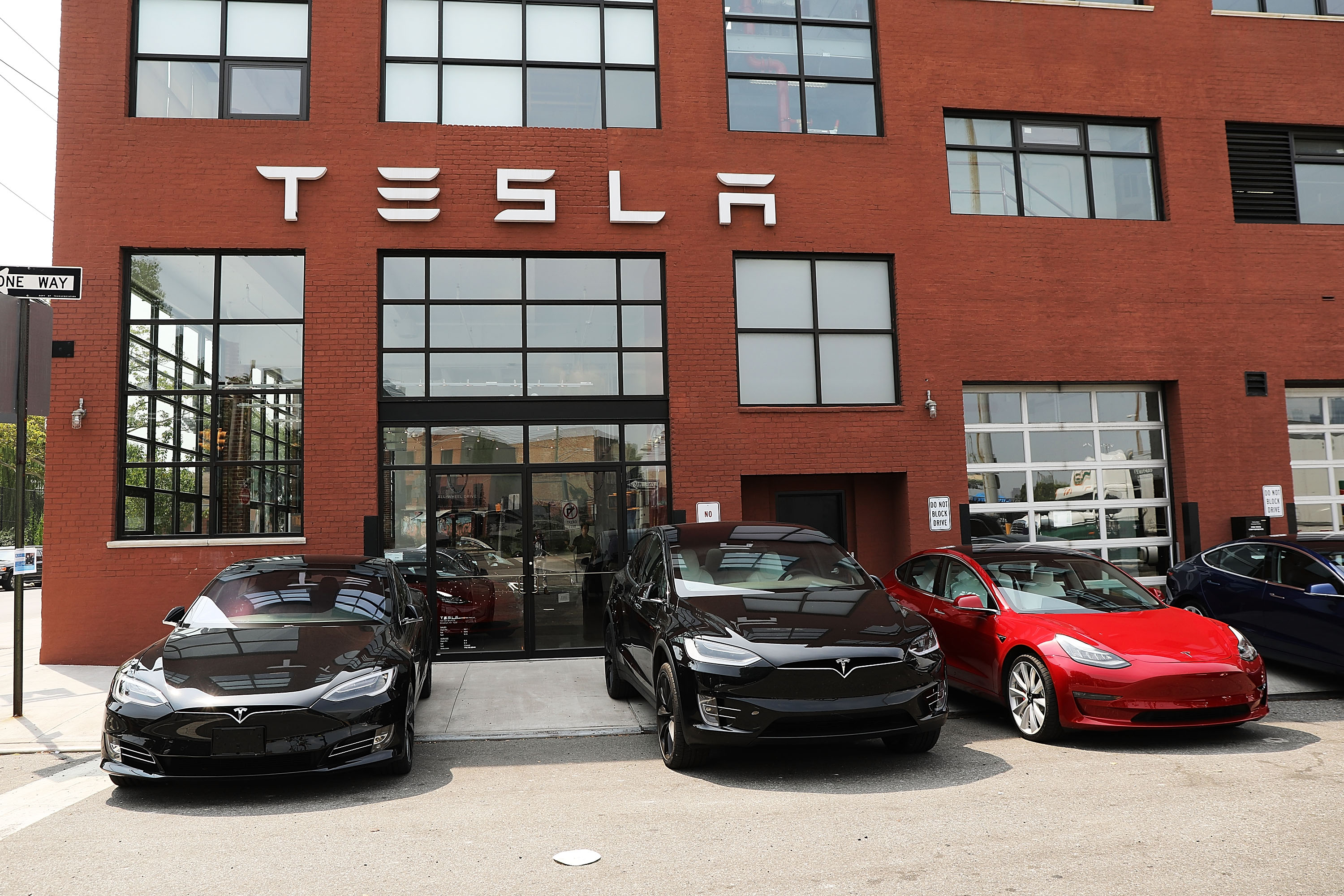 Tesla vehicles stand outside of a Brooklyn showroom and service center on August 27, 2018