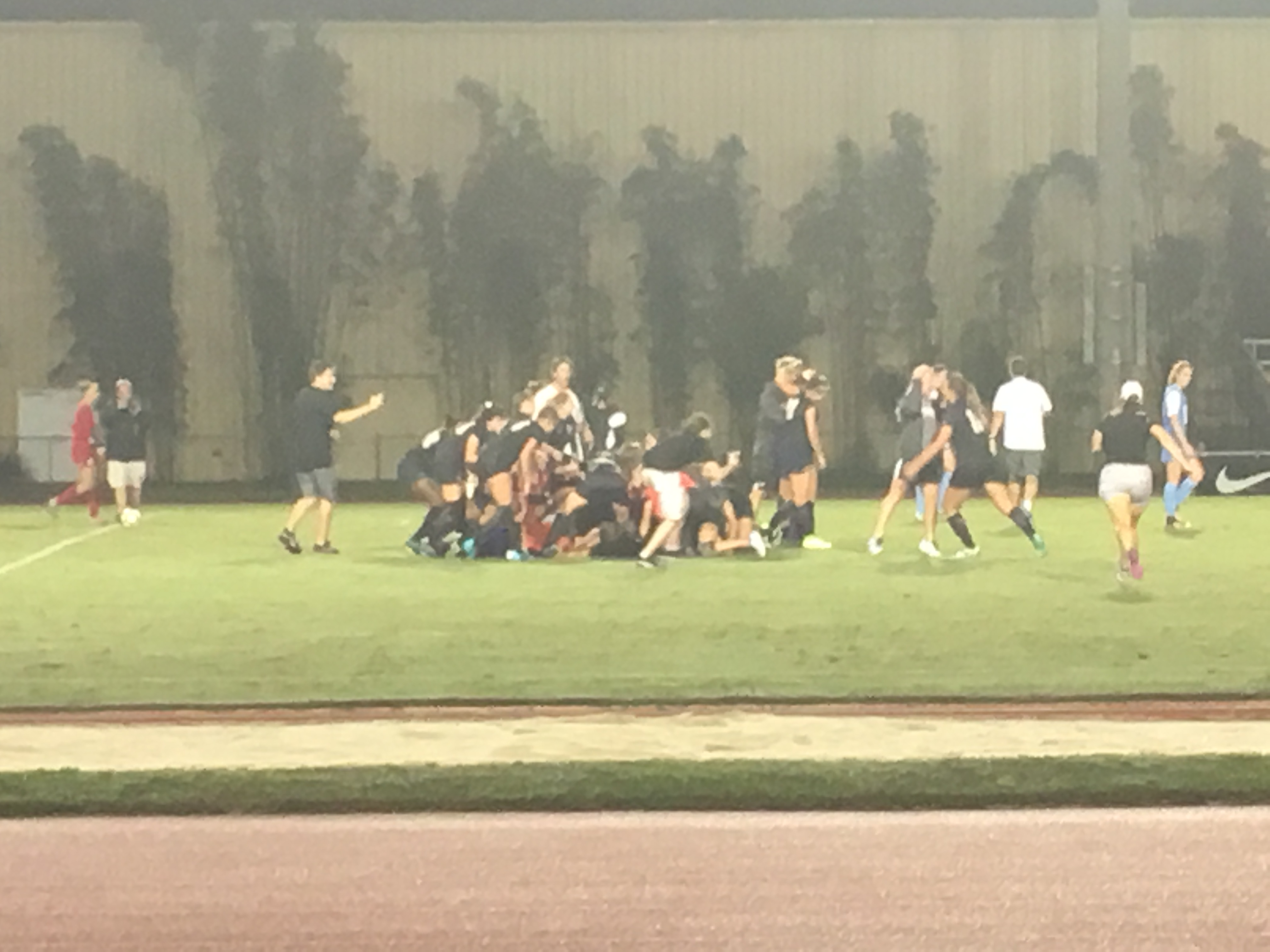 The UCF Women's Soccer Team celebrates Christine Creighton's golden goal that knocked off #4 North Carolina at the UCF Track and Soccer Complex on August 25th, 2017 (Photo: Jeff Sharon)