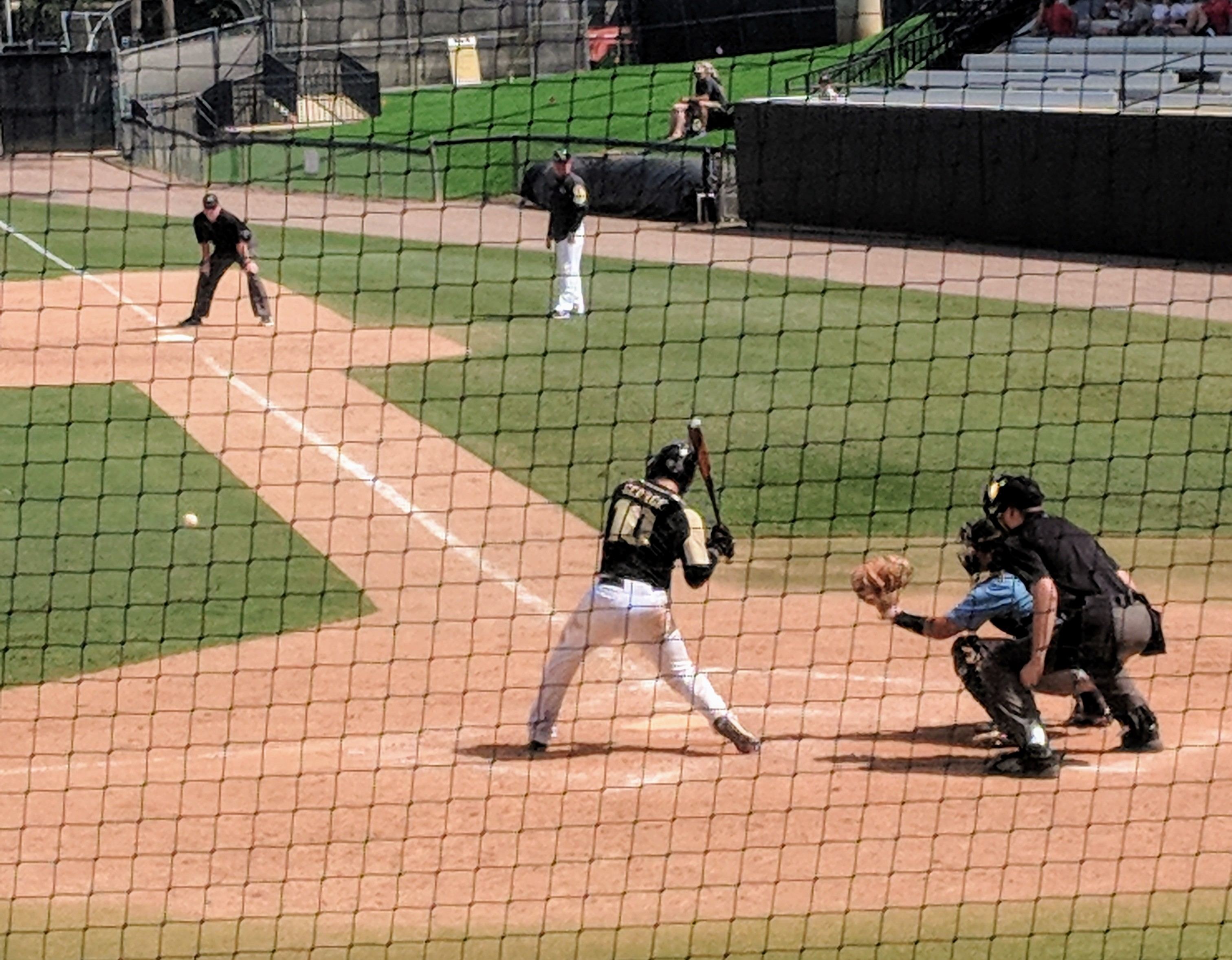 UCF catcher Anthony George takes a pitch during Sunday's game versus Seminole State. (Photo: Brian Murphy)