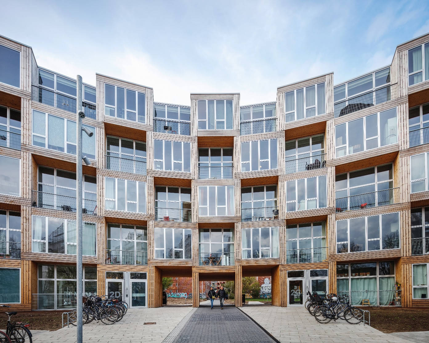 Front of curving building with bikes