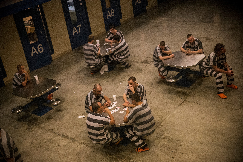 Inmates sit in the county jail in Williston, North Dakota