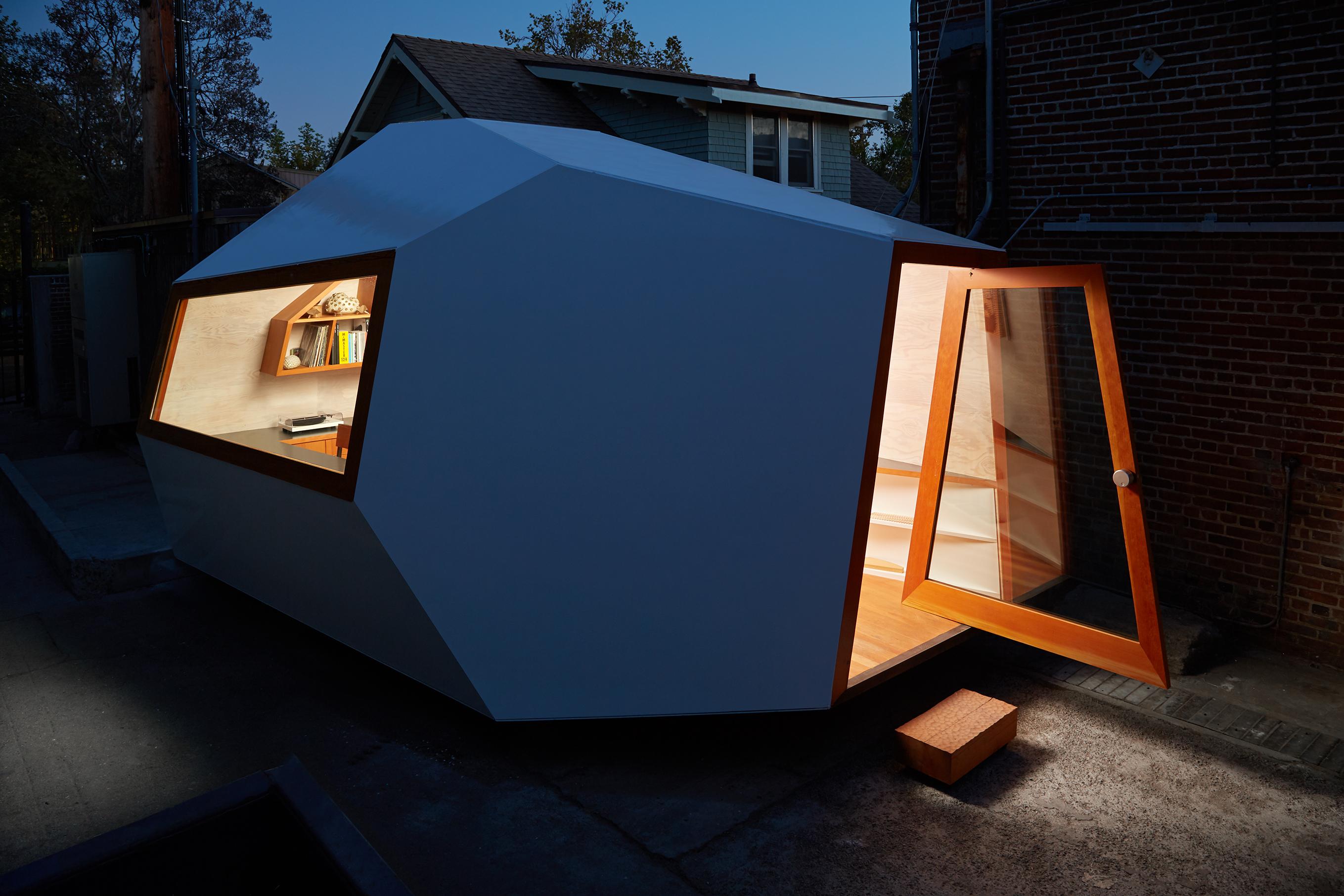 Small white angular building at night