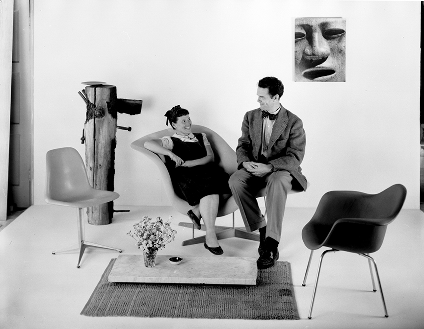 Charles and Ray Eames sitting on the La Chaise prototype, 1948.