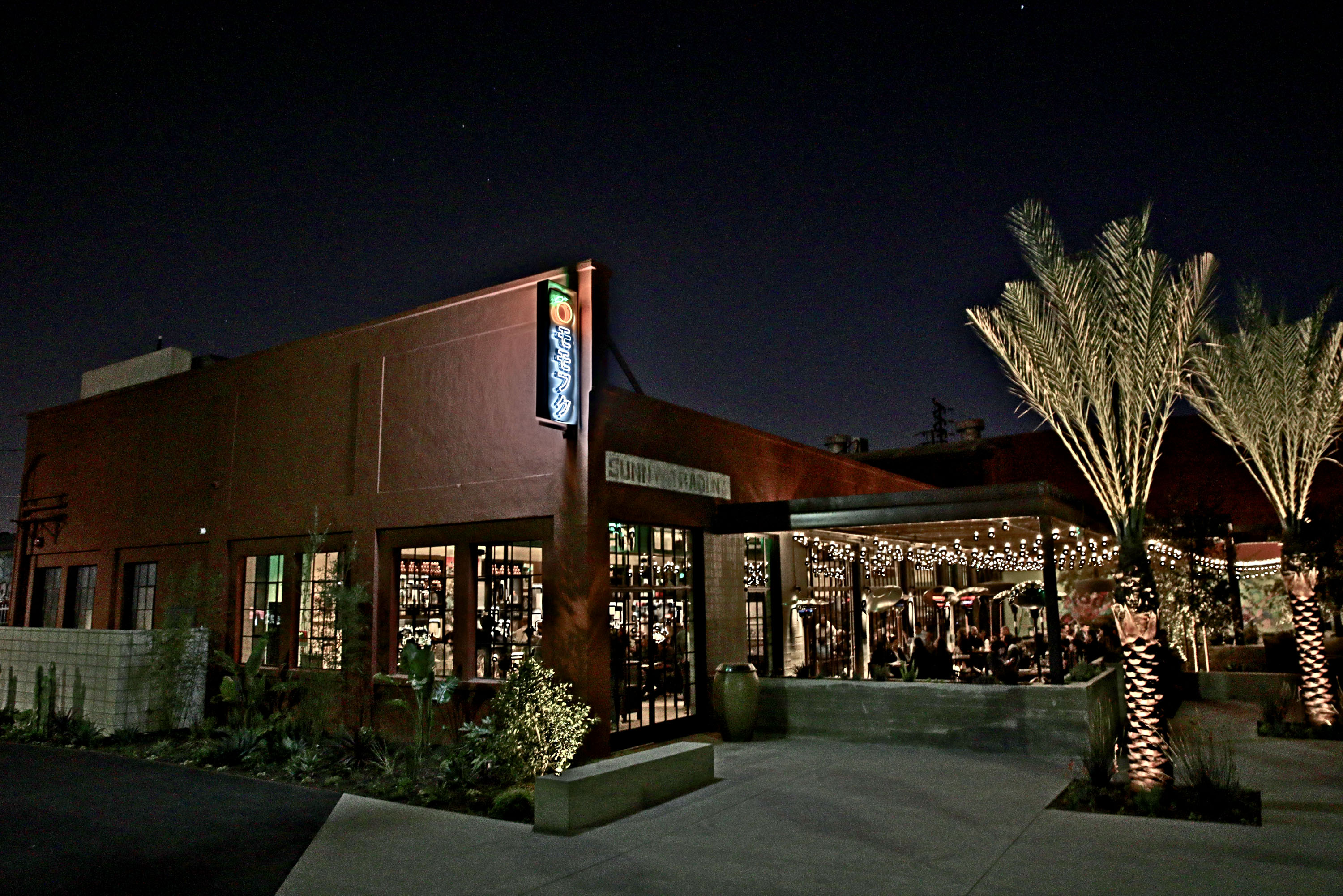 David Chang restaurant Majordomo in Los Angeles, CA, after dark and lit from within