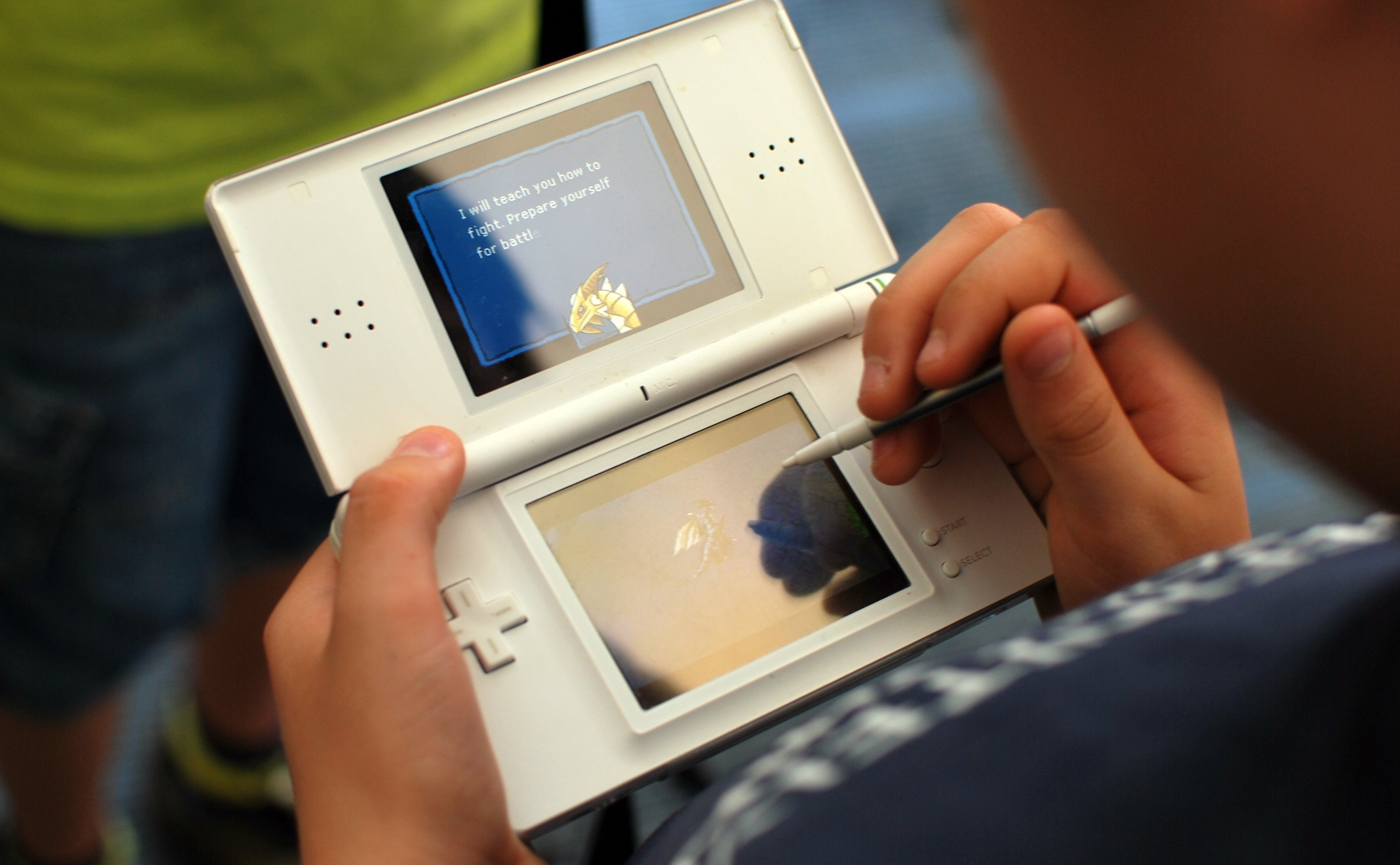 A child plays video games on a Nintendo DS