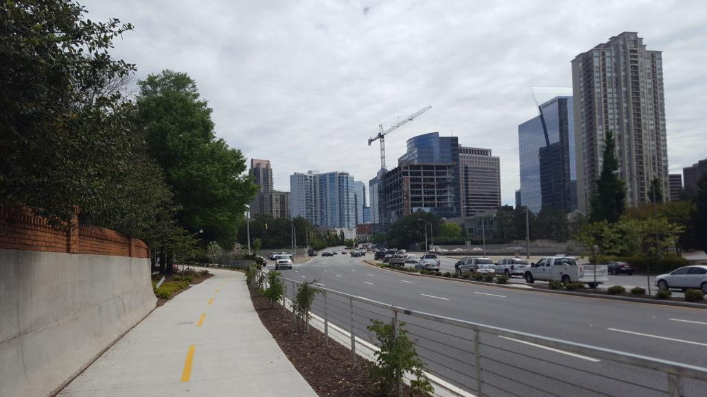 A paved trail runs alongside a busy road.