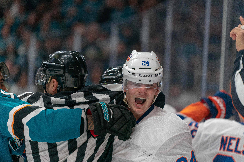 Oct 20, 2018; San Jose, CA, USA; New York Islanders defenseman Scott Mayfield (24) and San Jose Sharks left wing Evander Kane (9) fight during the second period at SAP Center at San Jose.