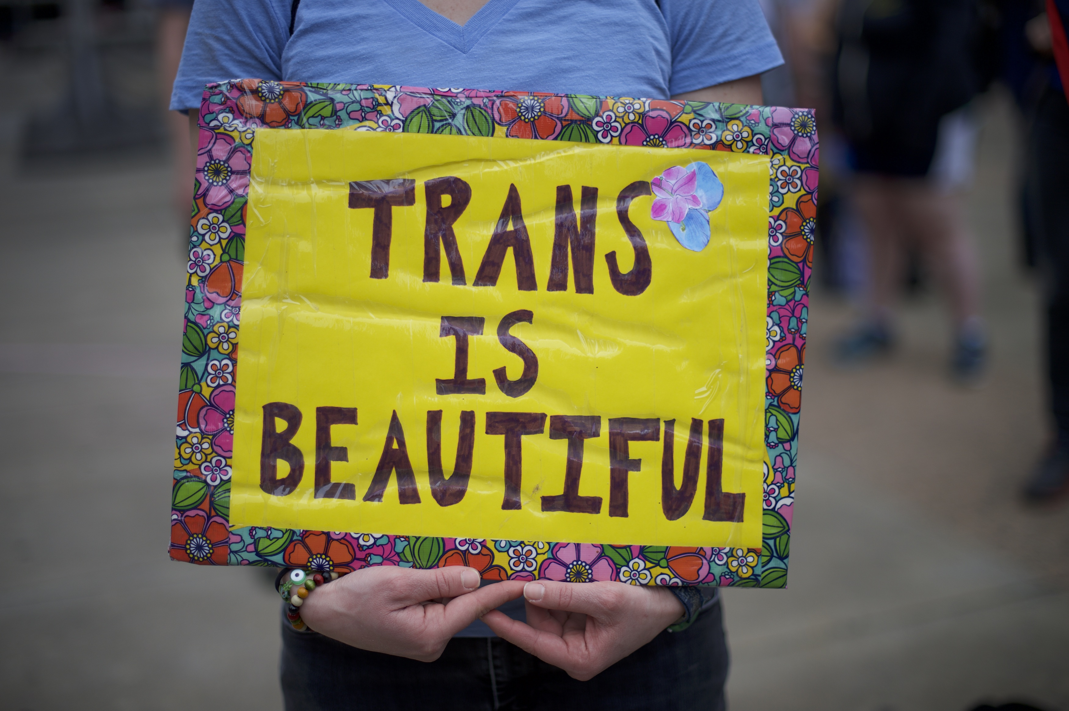 A sign at a demonstration for transgender rights.