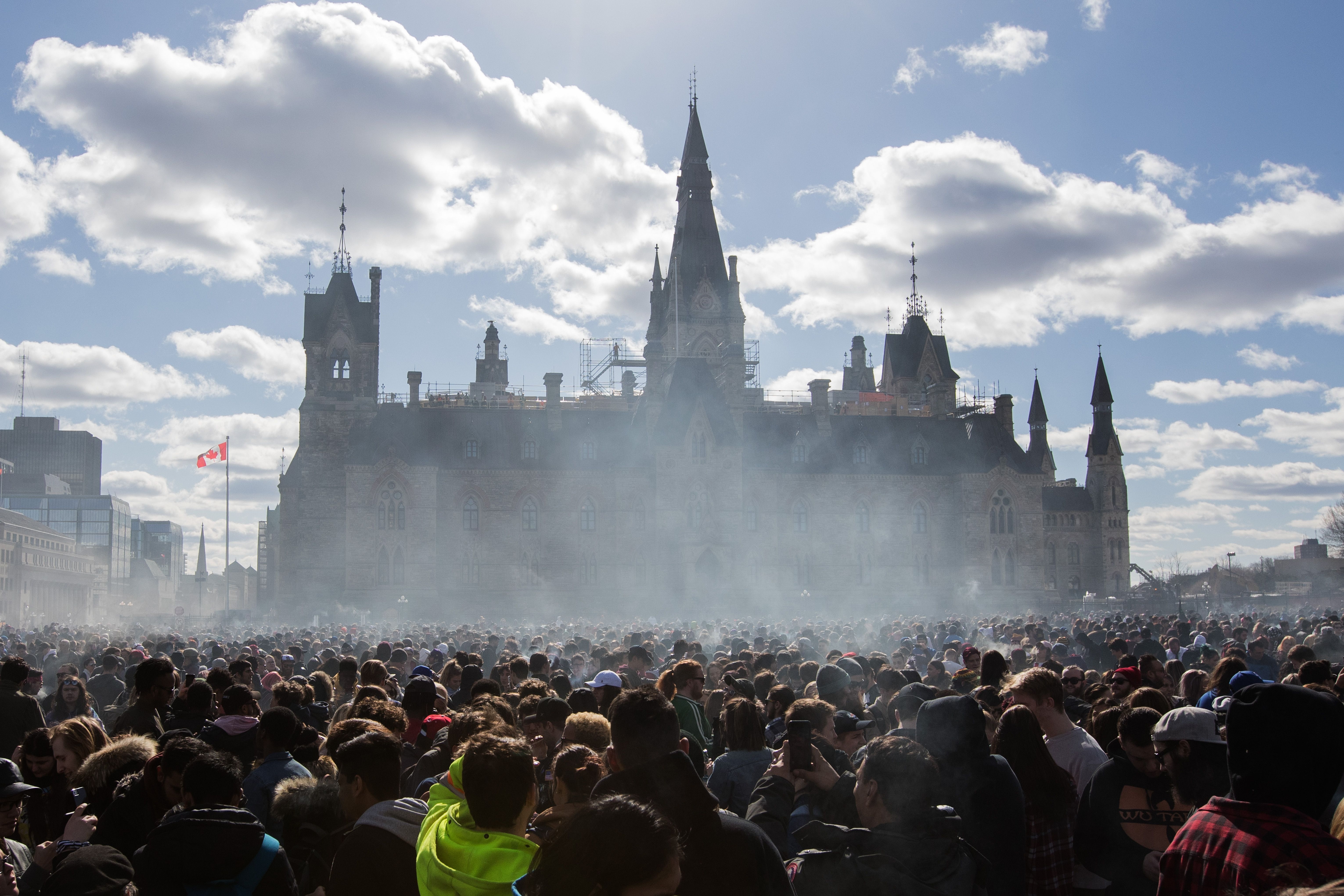Marijuana smoke lingers in front of Parliament Hill during a 4/20 rally in Ottawa, Ontario, in Canada.