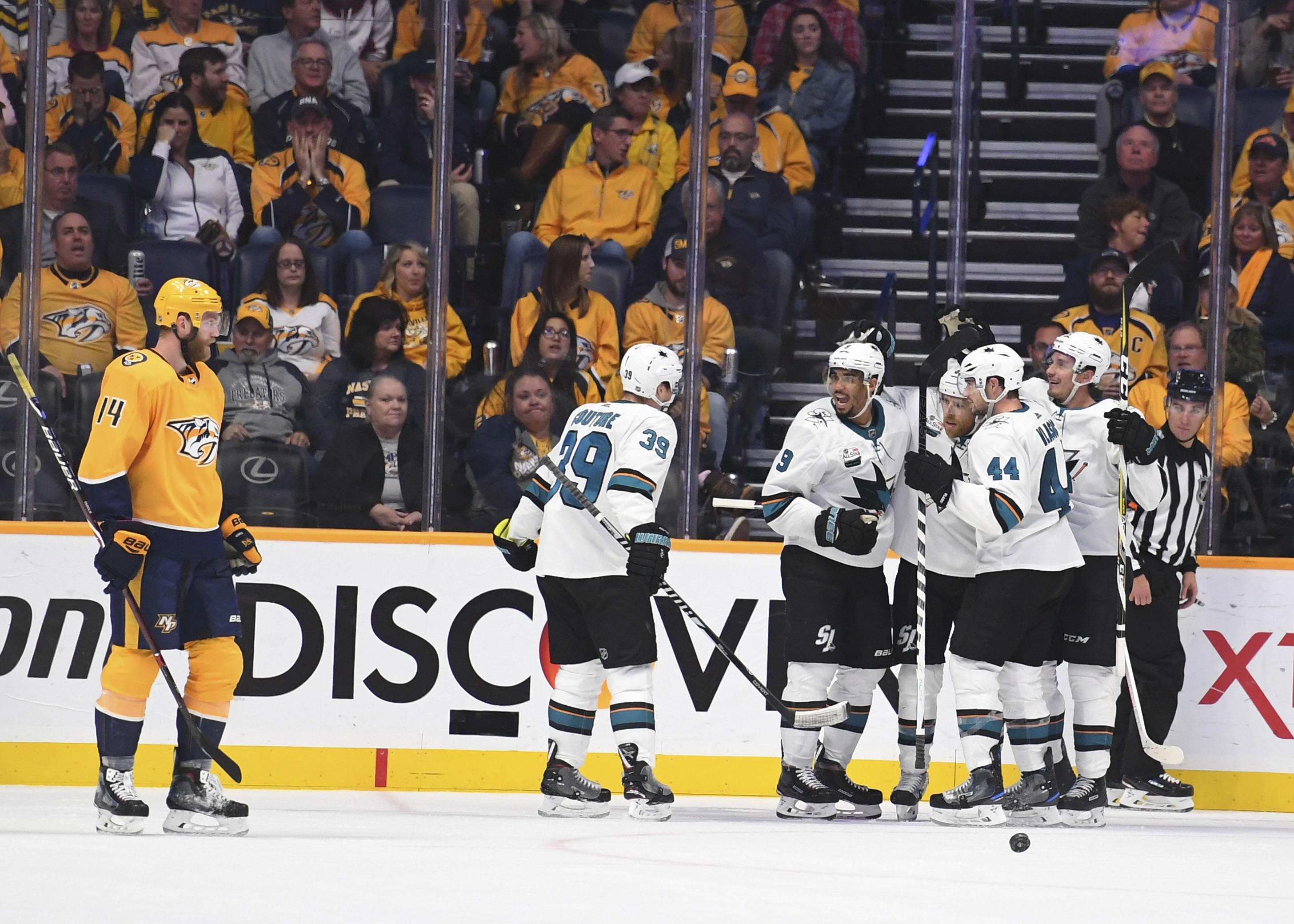 Oct 23, 2018; Nashville, TN, USA; San Jose Sharks players celebrate after a goal by center Joe Pavelski (8) during the third period against the Nashville Predators at Bridgestone Arena.