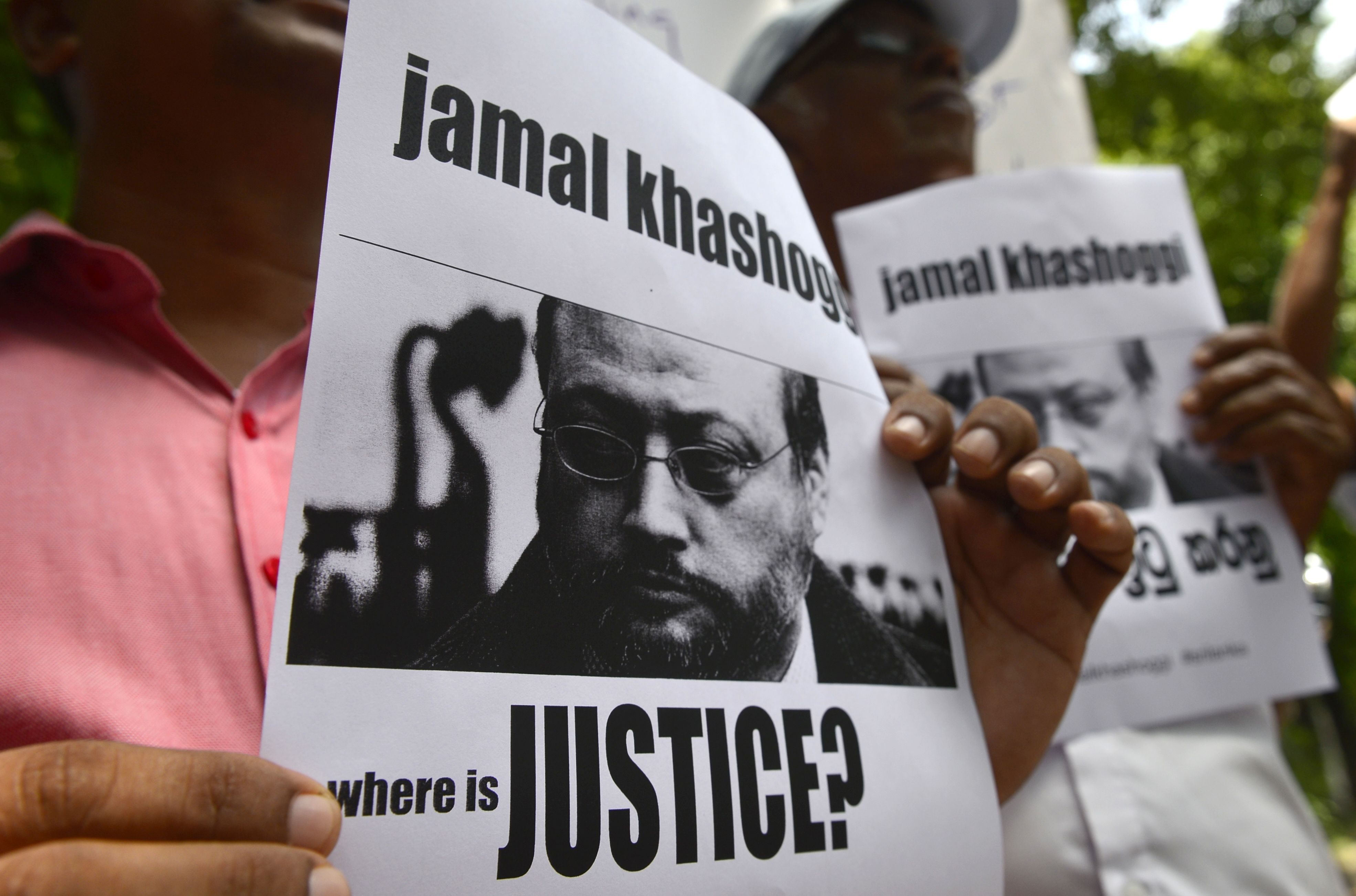 Members of the Sri Lankan web journalist association hold placards with the image of Saudi journalist Jamal Khashoggi during a demonstration outside the Saudi Embassy in Colombo on October 25, 2018,