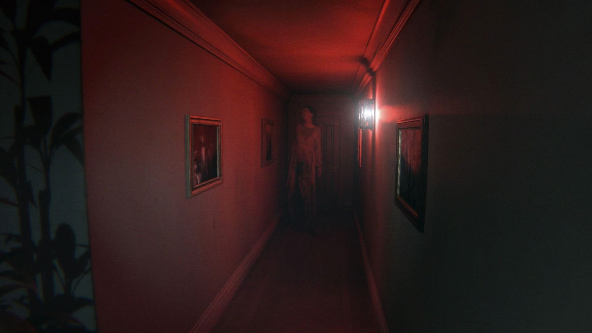 P.T. - woman at end of dimly lit red hallway