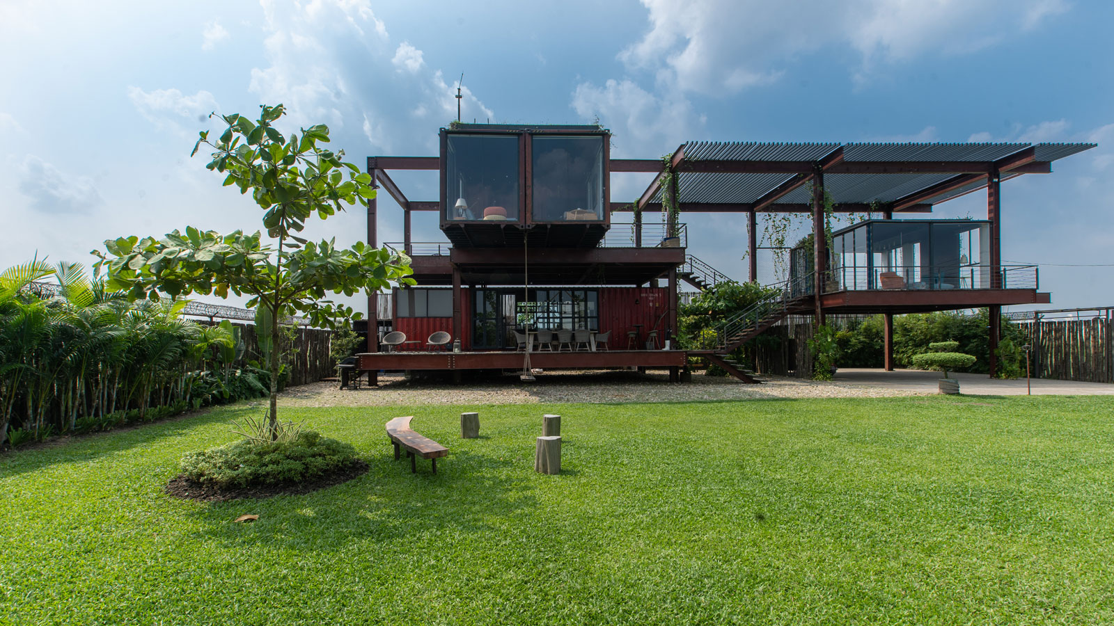 Shipping container house on green lawn