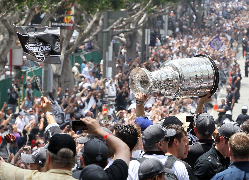 Los Angeles Kings captain Dustin Brown leads the team through a celebratory parade in the summer of 2012.