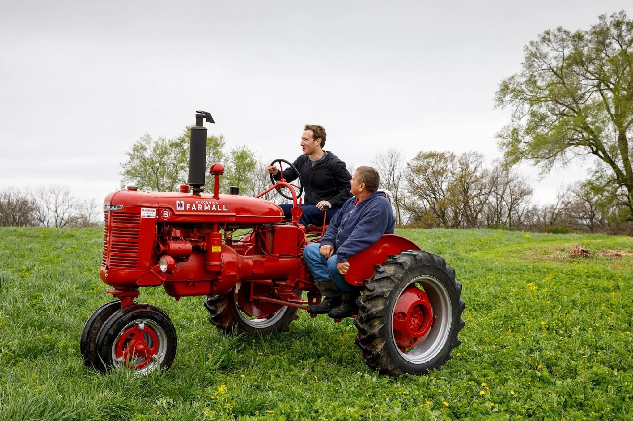 Facebook CEO Mark Zuckerberg drives a tractor on his tour of America.