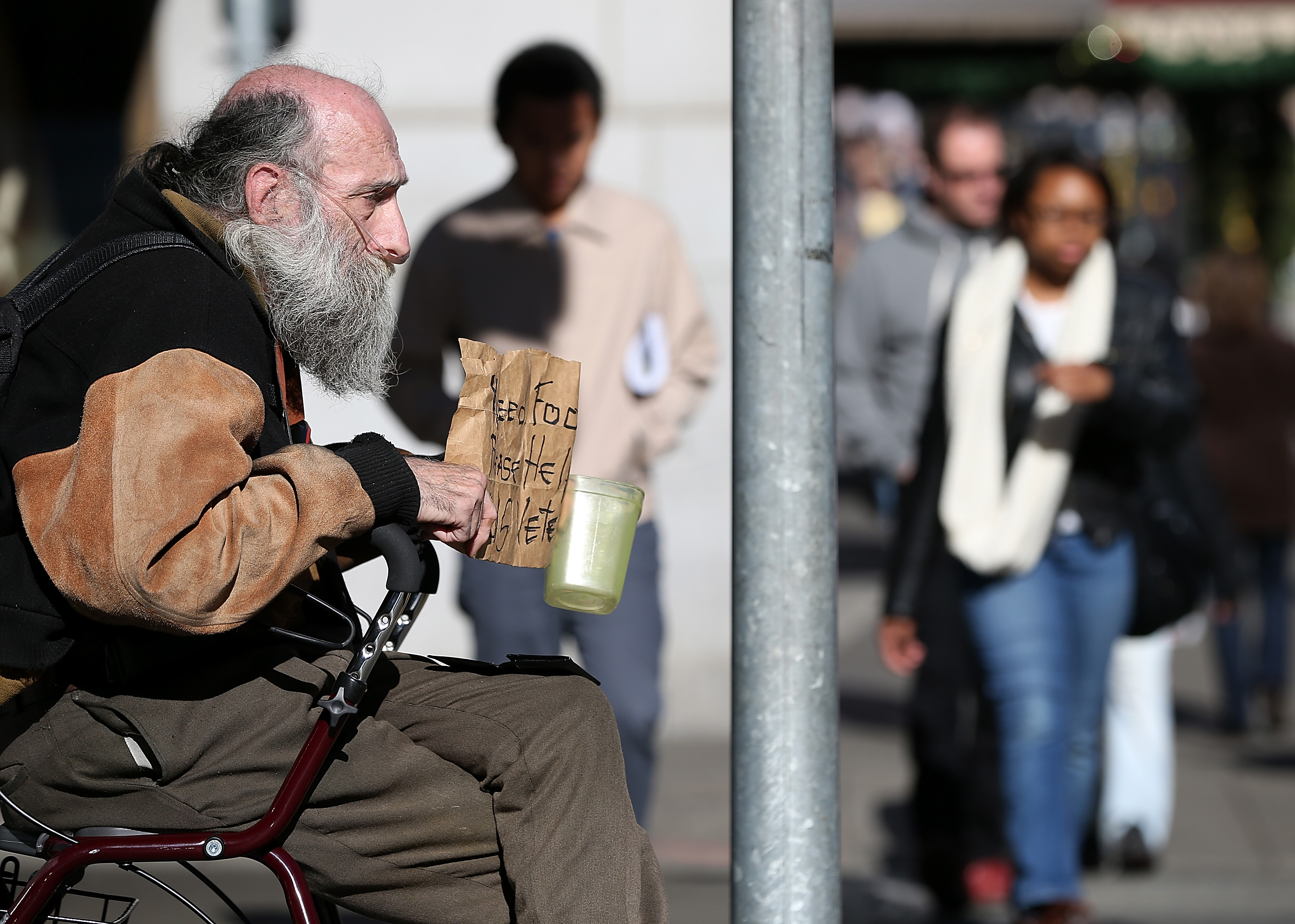 A homeless man begging for change in San Francisco.
