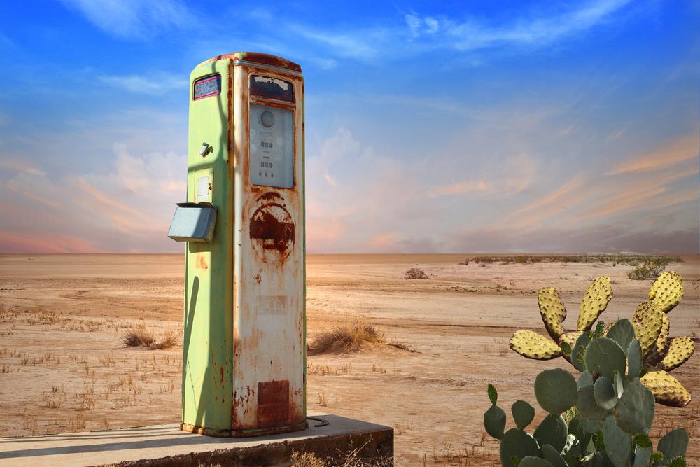 An antique gas pump in the desert.