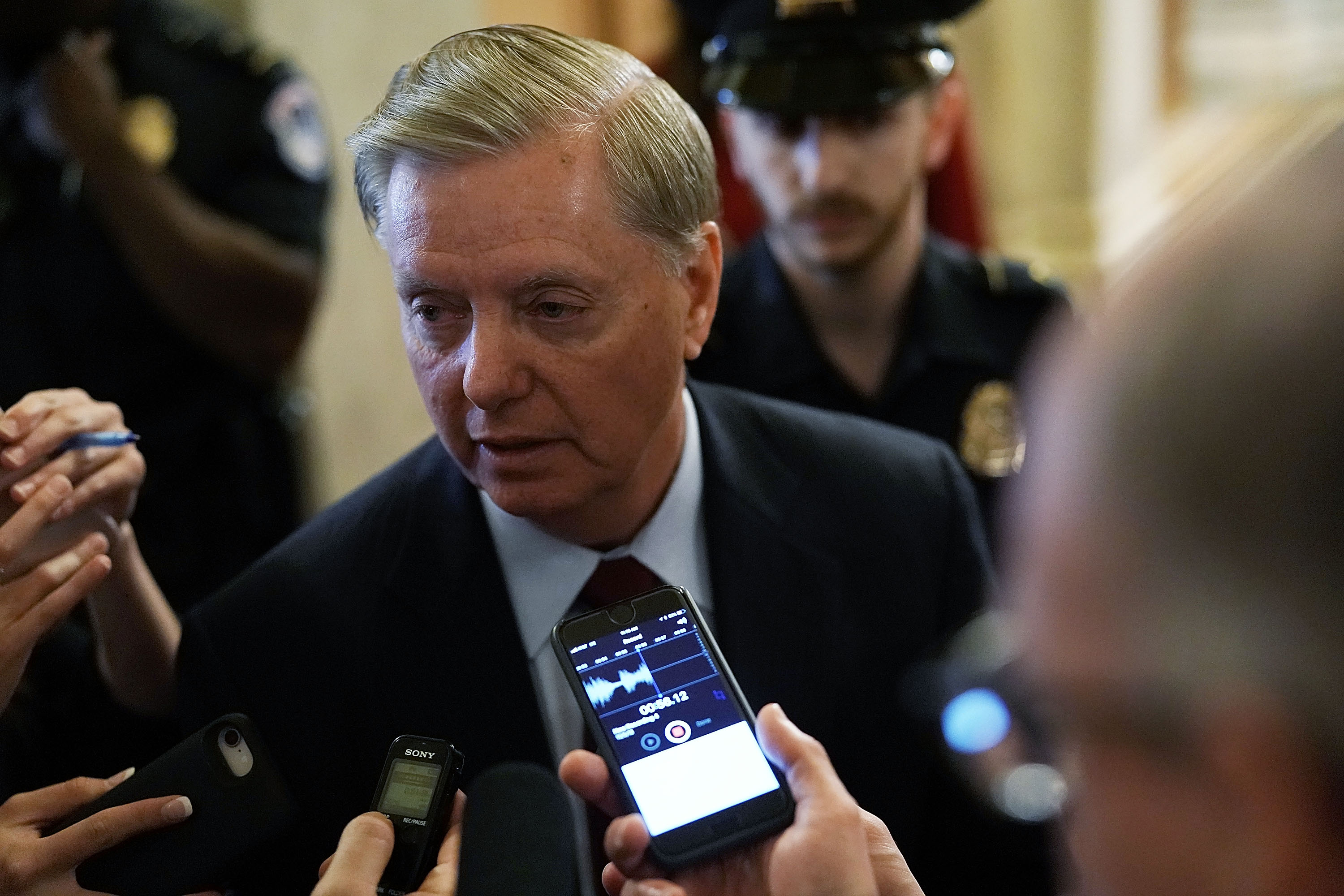 "Lindsey Graham said there'd be ""holy hell to pay"" if Trump fired Sessions. But that was then."