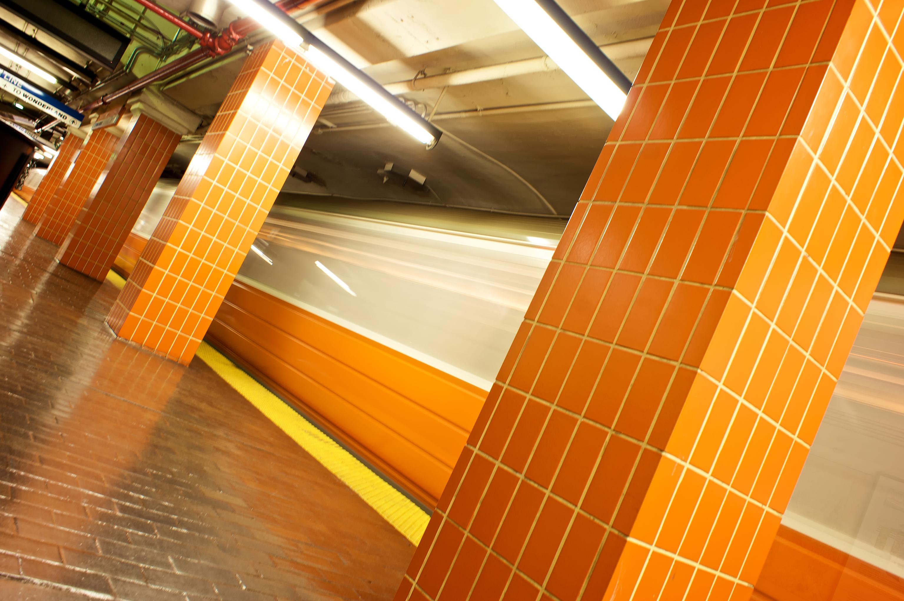 Boston's Orange Line zipping through a station.