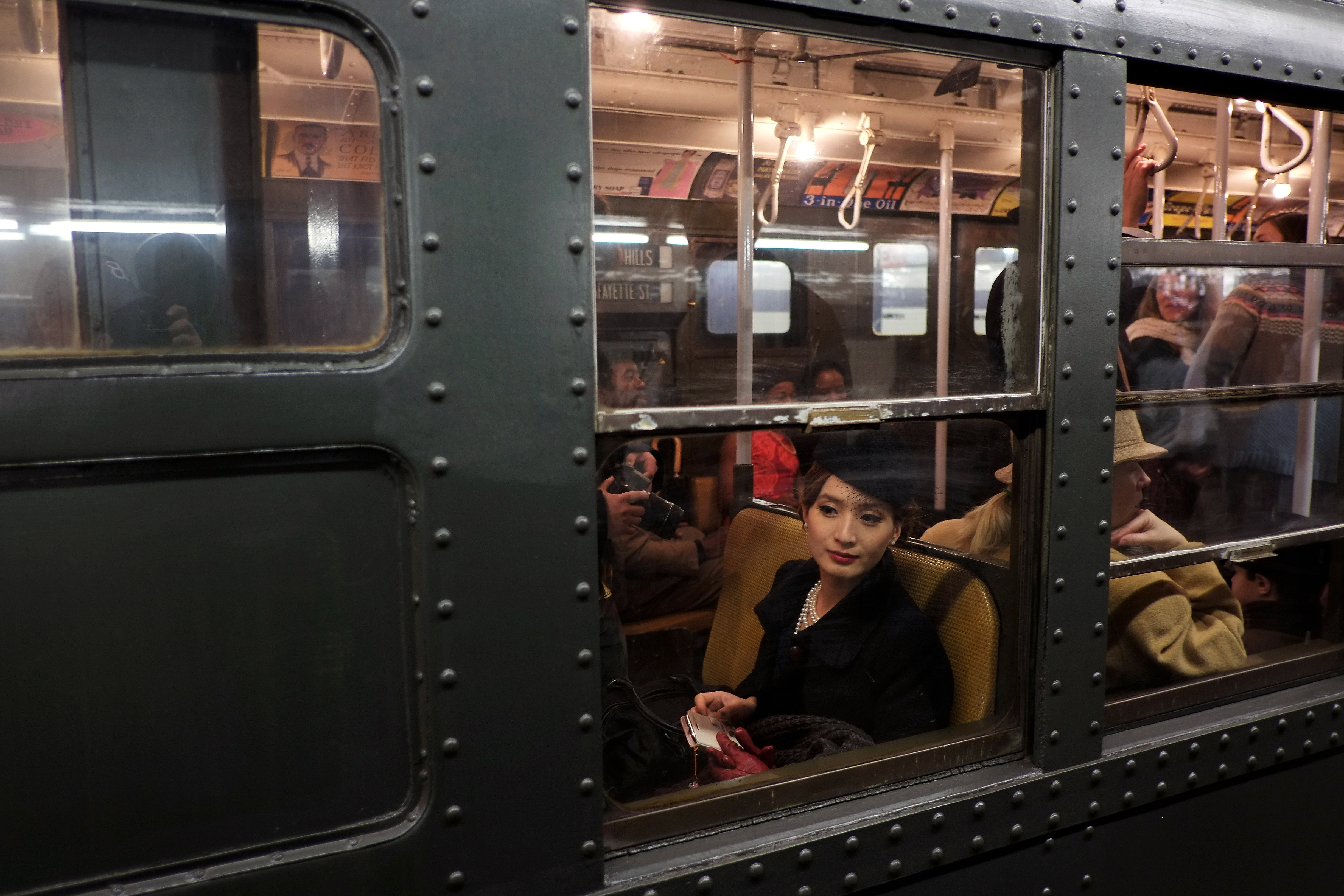 Riders Enjoy Vintage New York City Subway Trains In Annual Holiday Tradition