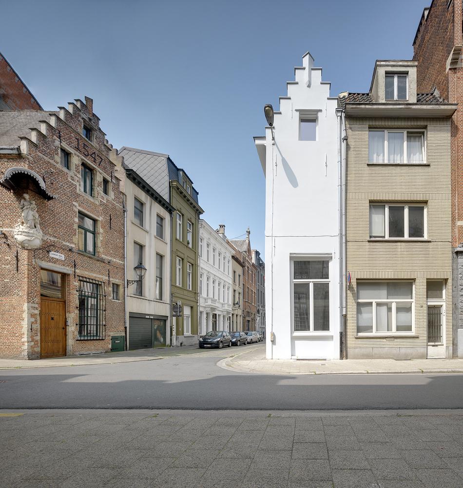 Narrow white house on corner