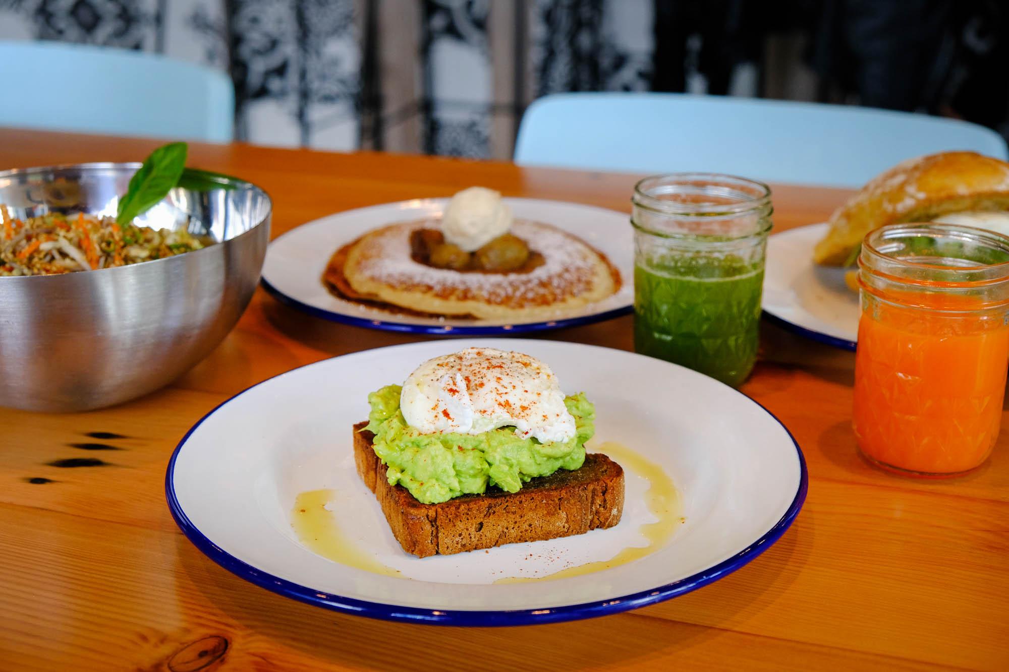Avocado toast on a white plate.