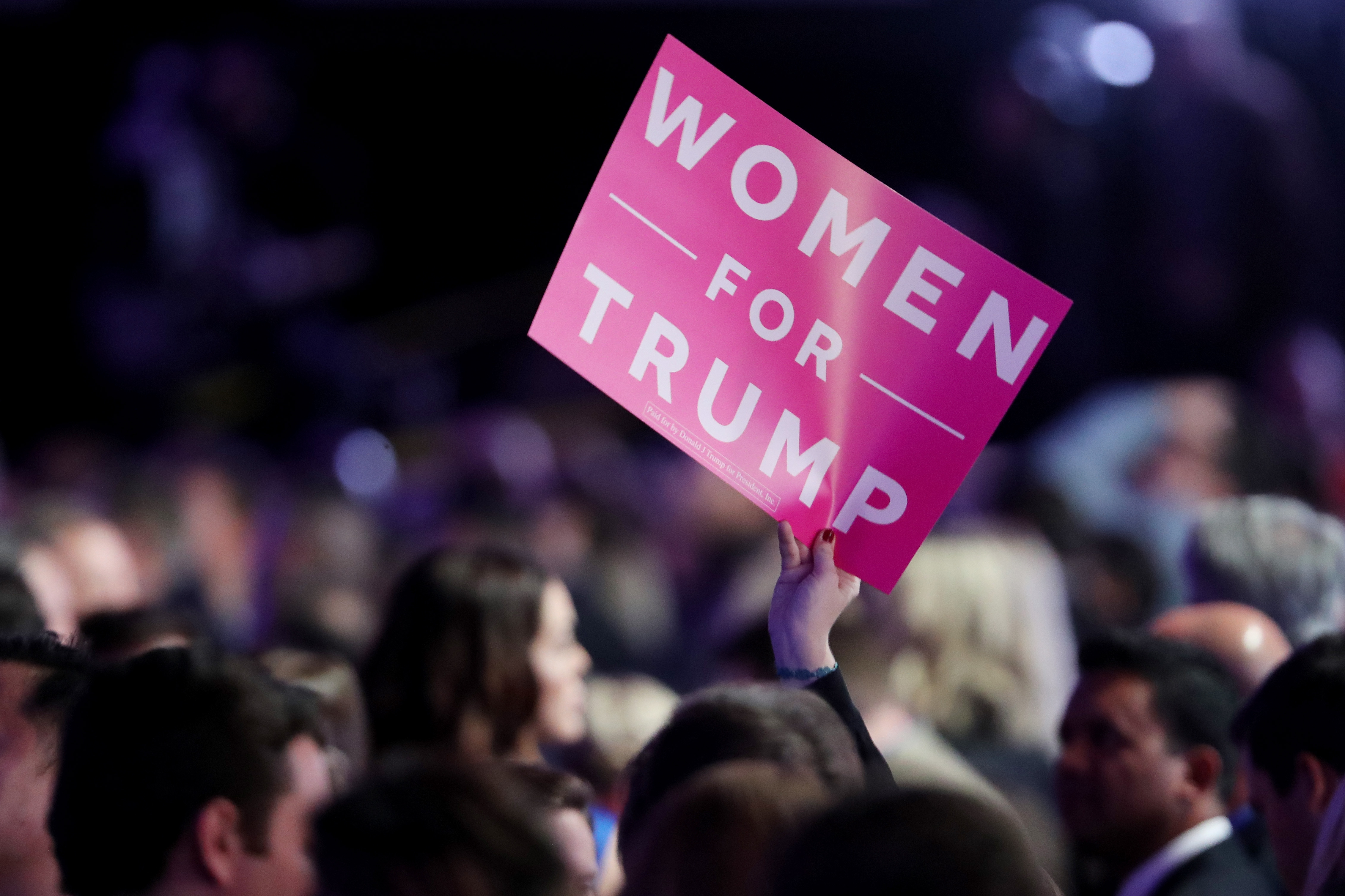 """A supporter of Donald Trump holds a """"Women For Trump"""" sign at the election night event at the New York Hilton Midtown on November 8, 2016."""