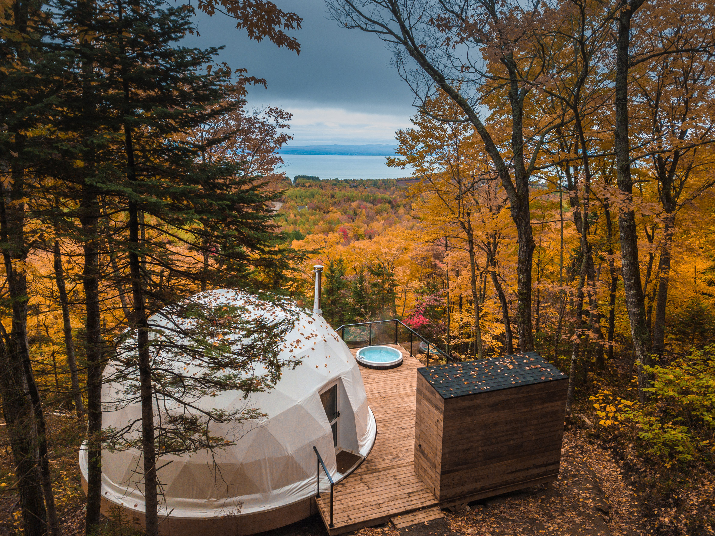 Dome on wooden deck overlooking trees