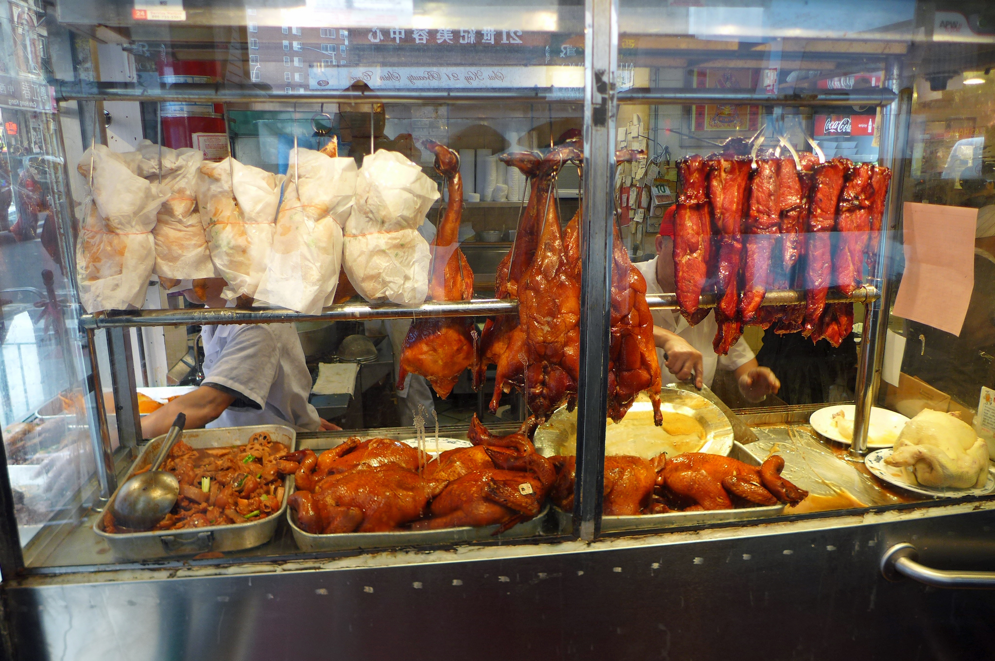 The collection of preserved meats, poultry, and seafood in the window is enough to draw you in.