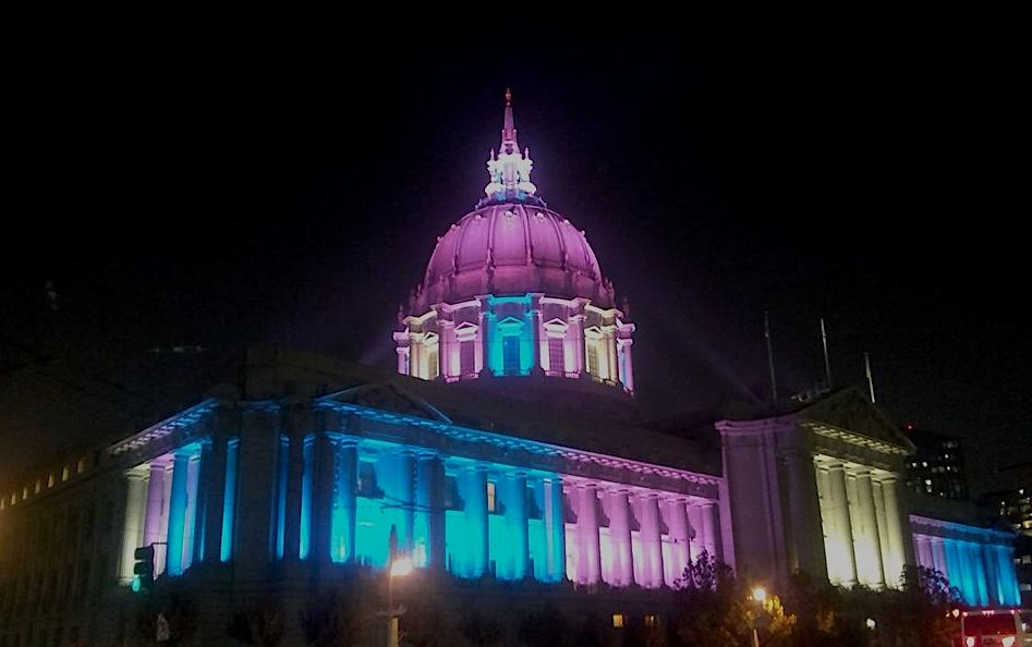 Blue, pink, and white lights on the San Francisco City Hall.