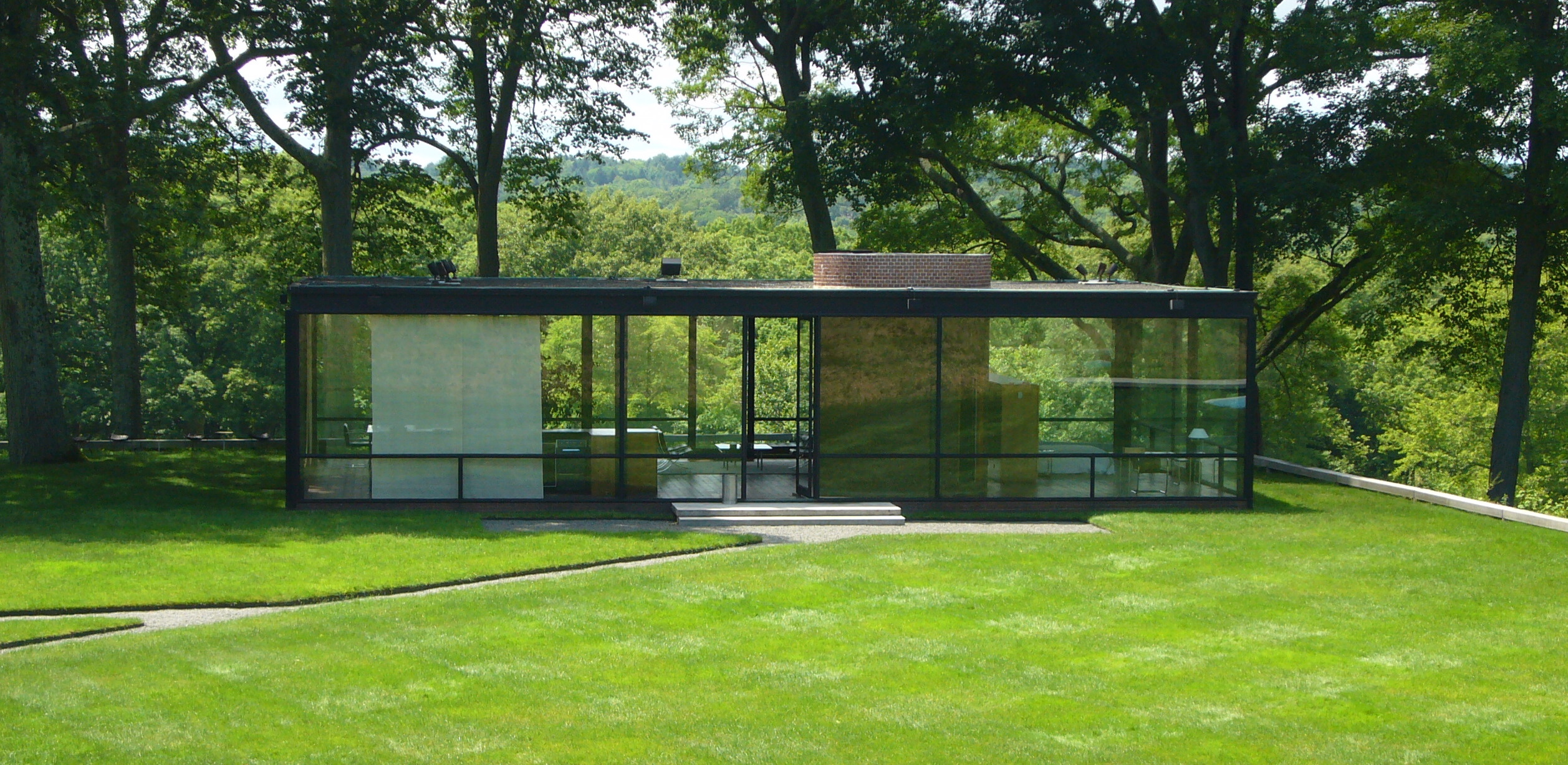 Philip Johnson's Glass House in New Canaan, Connecticut. A new book by Dallas Morning News architecture critic Mark Lamster examines Johnson's life and legacy.