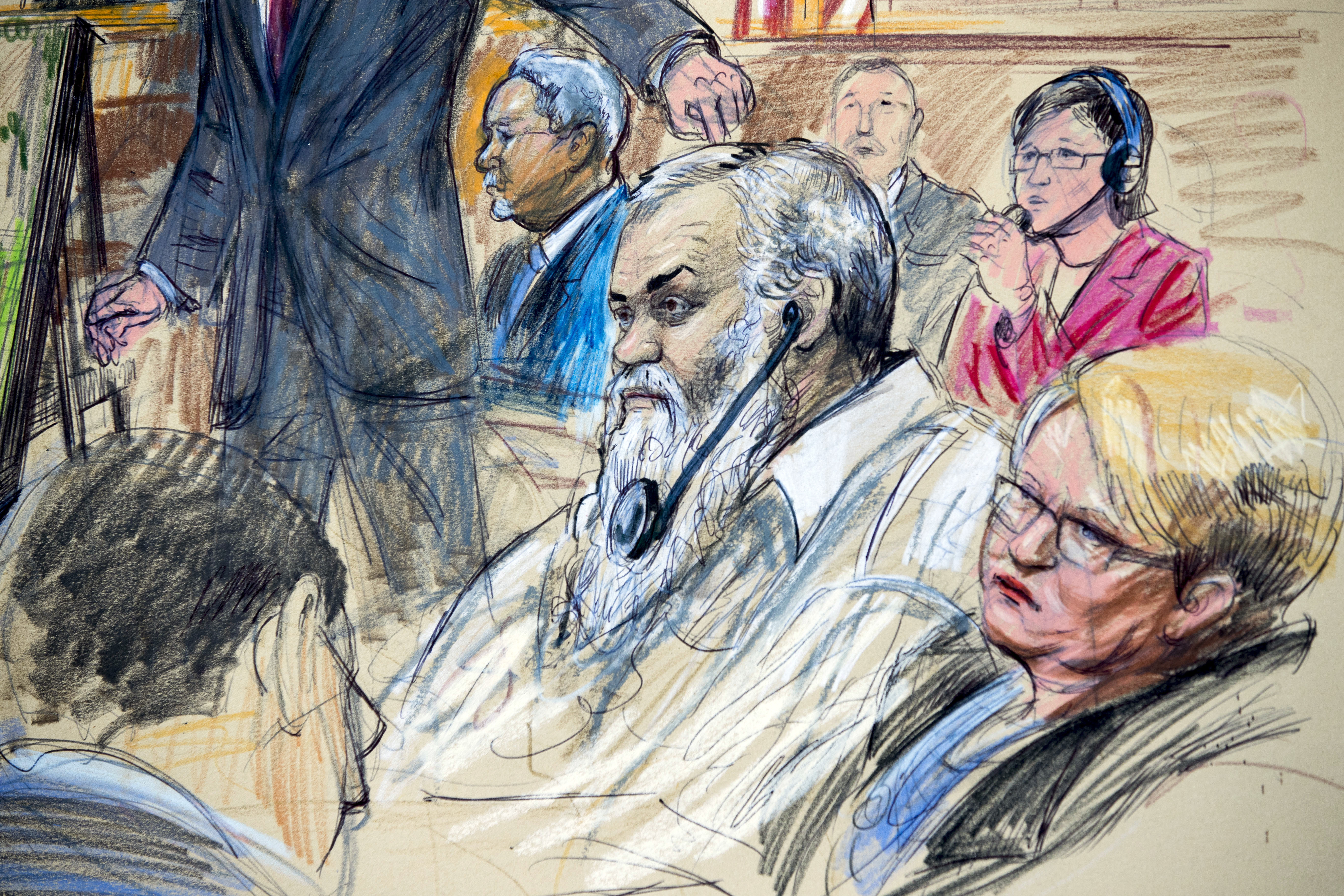 FILE - This Oct. 2, 2017, file courtroom sketch depicts Ahmed Abu Khattala listening to a interpreter through earphones during the opening statement by assistant U.S. attorney John Crabb, second from left, at federal court in Washington, in the trial presided by U.S. District Judge Christopher Cooper. Defense attorney Jeffery Robinson, sits behind Crabb in a light blue suit and Michelle Peterson, also a member of the defense team, is at far right. A federal jury has found a suspected Libyan militant not guilty of the most serious charges stemming from the 2012 Benghazi attacks that killed the U.S. ambassador and three other Americans. Jurors on Nov. 28, 2017, convicted Ahmed Abu Khattala of terrorism-related charges but acquitted him of murder. (Dana Verkouteren via AP)